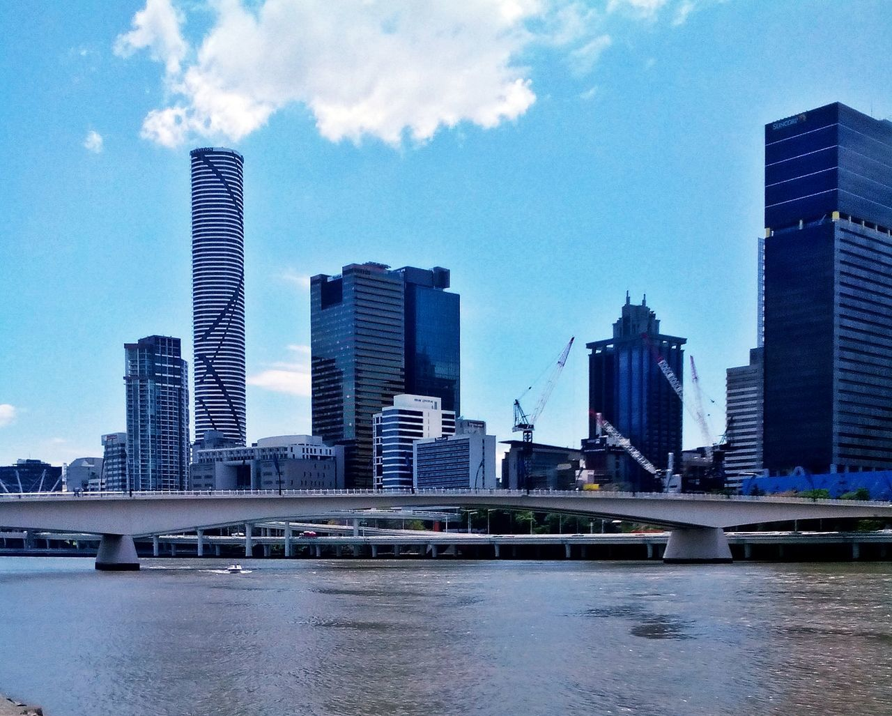 Architecture Bridge - Man Made Structure Brisbane Brisbane River Building Exterior Built Structure City Cityscape Cloud - Sky Day Downtown District Low Angle View Modern No People Office Building Exterior Office Park Outdoors Reflection River Sky Skyscraper Urban Skyline Water Waterfront Adapted To The City The Architect - 2017 EyeEm Awards