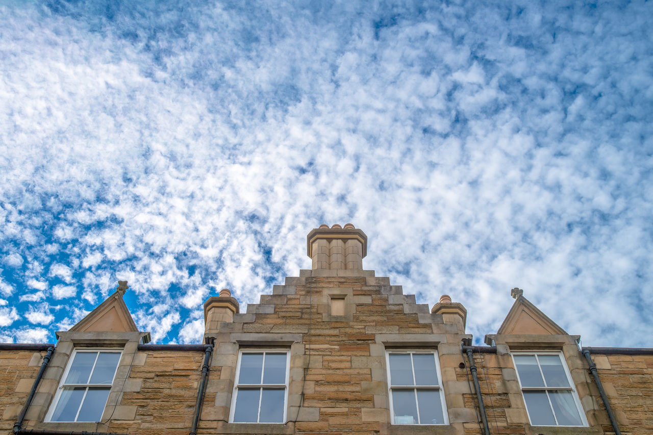 Edinburgh old residential building under dreamy cloudy sky. Accommodation Accommodation For Travellers Architecture Blue Sky Building Exterior Built Structure Cloud Cloud - Sky Cloudy Dreamy Edinburgh Low Angle View Residential Building Scotland Sky Travel Windows