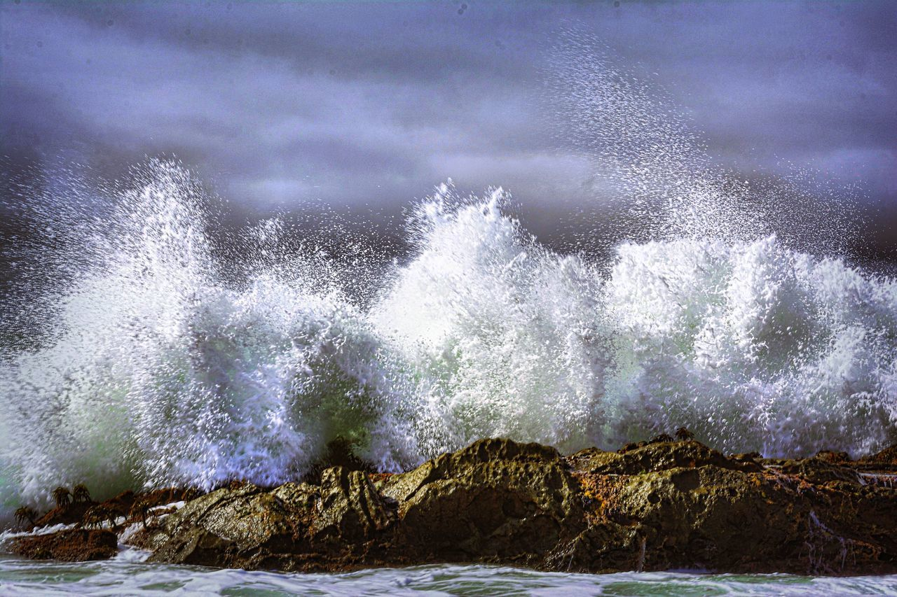 Strong Wave Splashing On Rocks