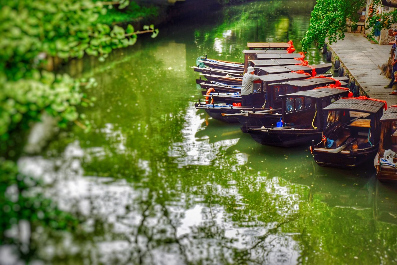 Punter In The Scenery Ancient Town Contryside Green Color Leisure Activity Lifestyles Mode Of Transport Nautical Vessel Real People Reflection Transportation Water Watertown