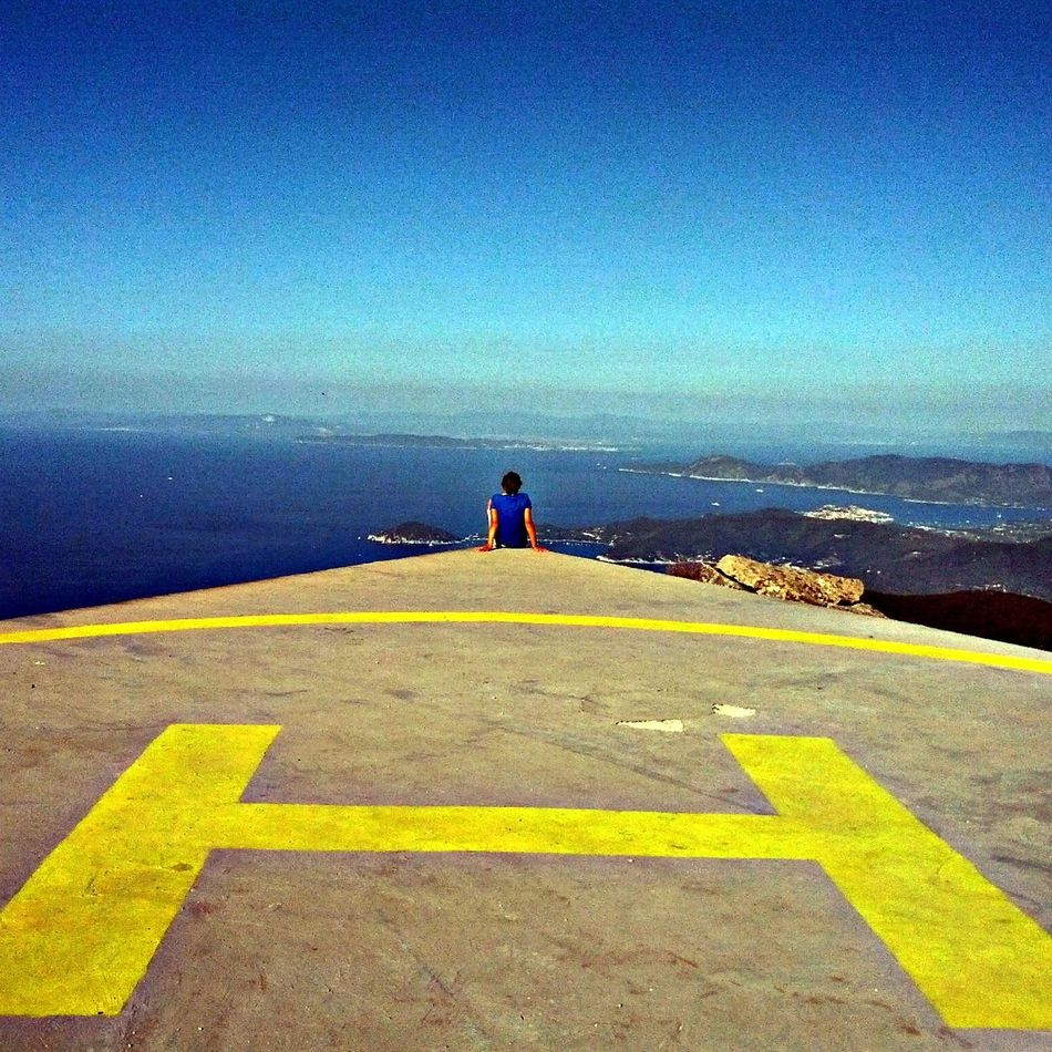 Break The Mold Beauty In Nature Selfıe Italy Tranquility Seascape Helicopter Platform Sea And Sky Perspective View Perspective Tirrenic Sea Coastline Landscape Blue Sky One Person Me, My Camera And I Outdoors Nature Yellow