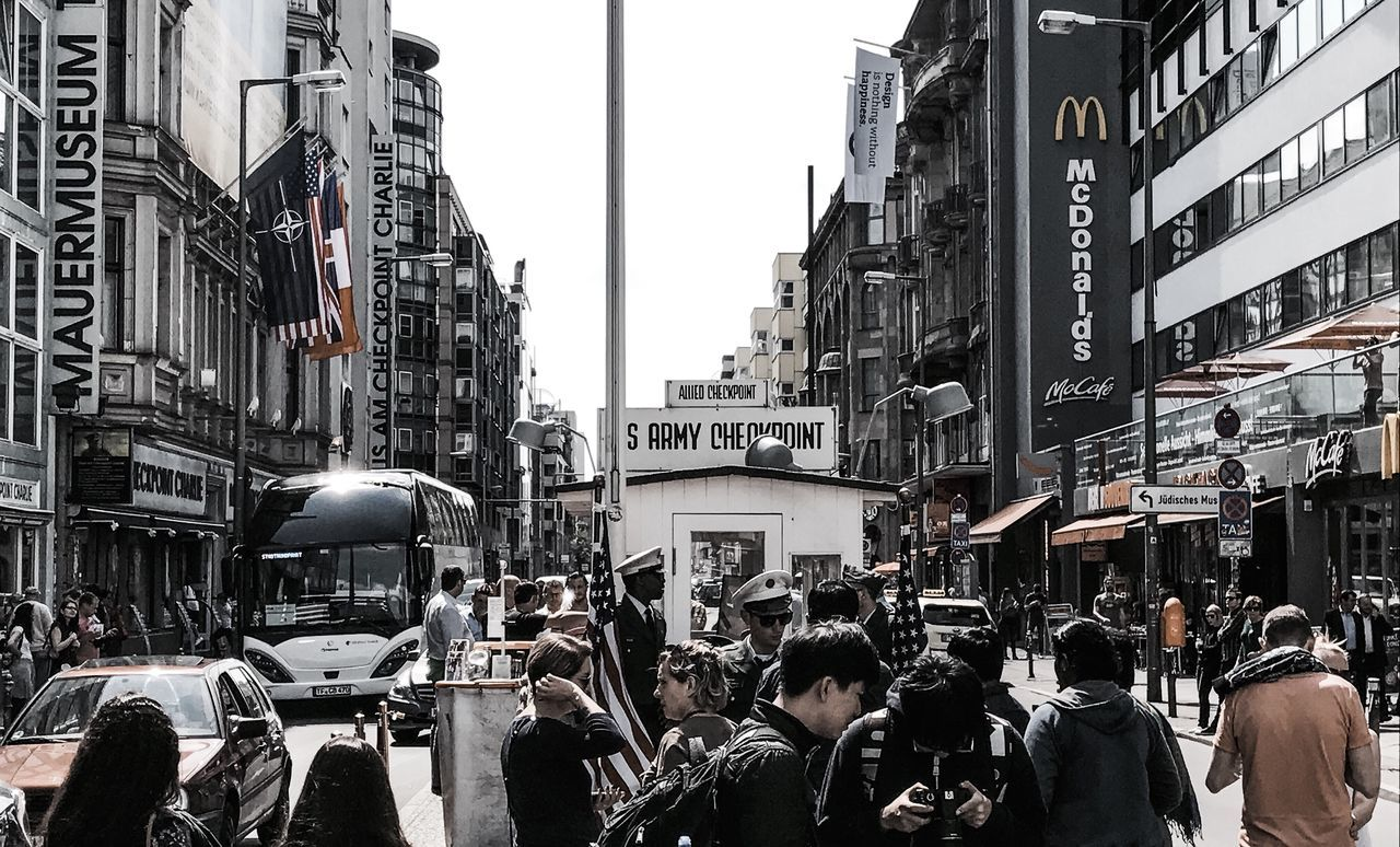 Building Exterior Large Group Of People Architecture City Street Built Structure City Street City Life Real People Crowd Car Men Day Outdoors Adult People Sky Adults Only Stanleyreagh Checkpointcharlie Berlin