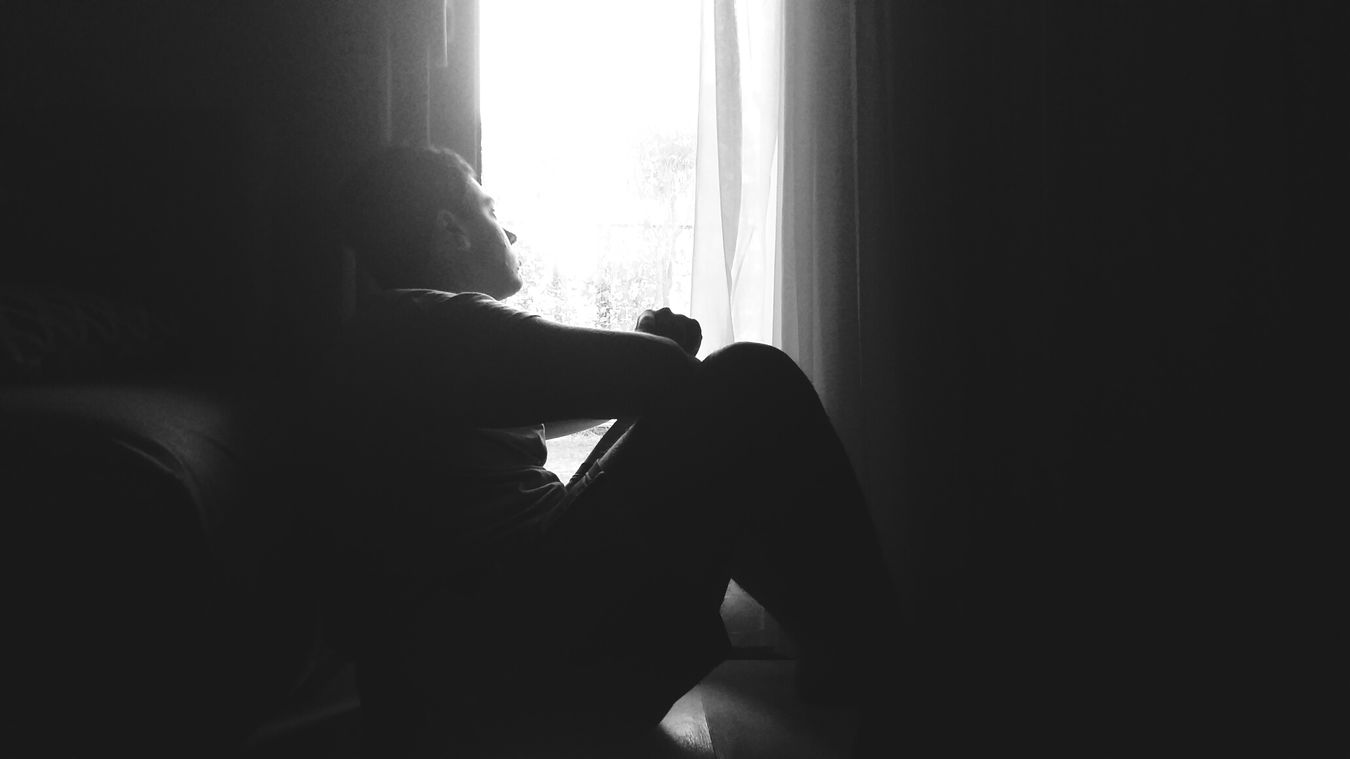 Indoors  One Person Sitting Comfortably Blackandwhite B&w Photography Low Angle View Lowlightphotography Lowlight Lonely Looking Out The Window Depressed