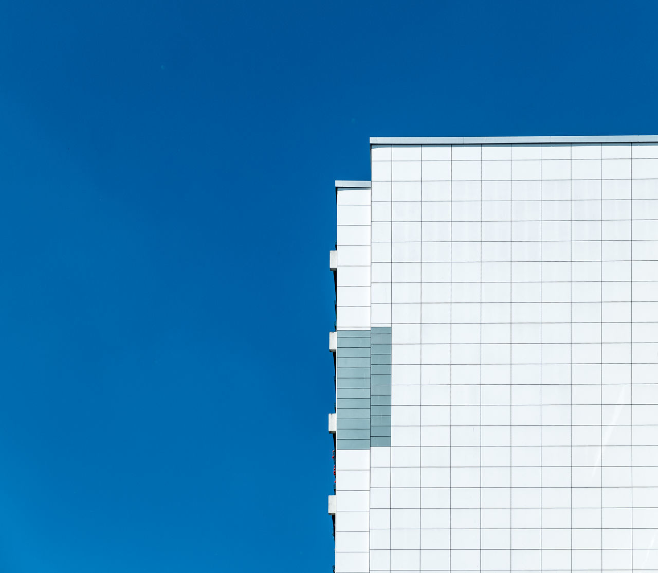 Whitefacade architectural detail architectural feature Architecture Architecture_collection architecturelovers blue building built structure cityexplorer Cityscape Clear sky facade building Façade From My Point Of View minimal minimalism Minimalist minimalistic minimalobsession Modern Modern Architecture no people Fine Art Photography simplicity Minimalist Architecture