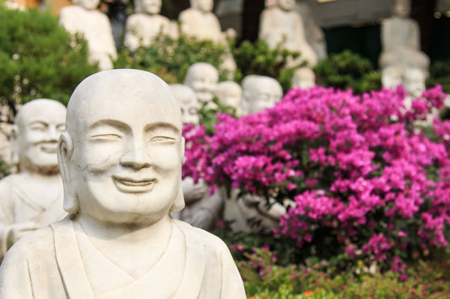 Kaohsiung, Taiwan - December 15, 2015 : Hand carved Buddha at the entrance of Fo Guang Shan. Art ASIA Asian  Asian Culture Buddha Buddha Buddha Statue Carving - Craft Product Close-up Craft Creativity Day Flower Fo Guang Shan Focus On Foreground Human Representation Kaohsiung Religion Sculpture Statue Stone Material Summer Taiwan Temple - Building Tradition
