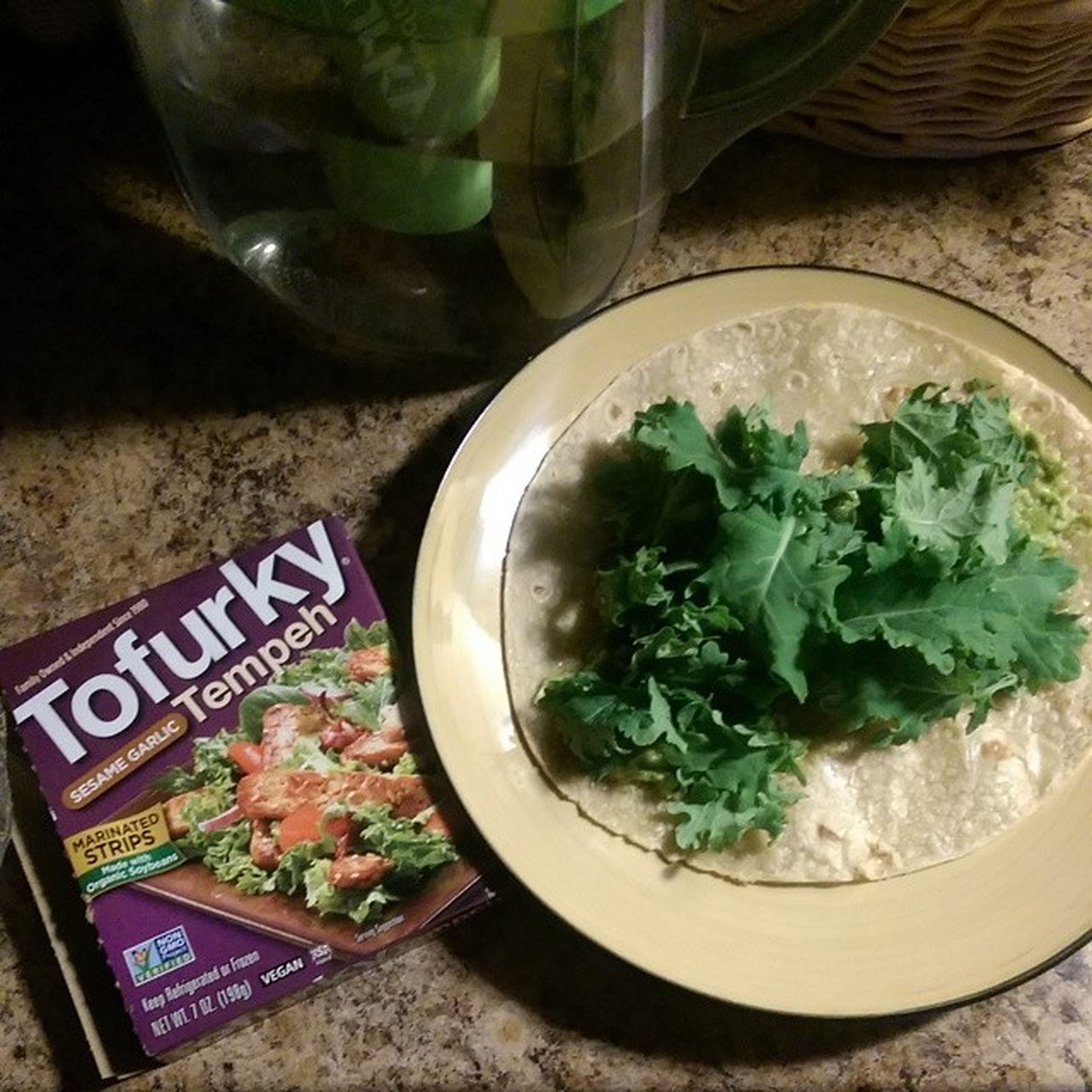 Dinner Tofurky Sesamegarlic Tempeh in a foodforlife brownrice wrap with guacamole and babykale organic