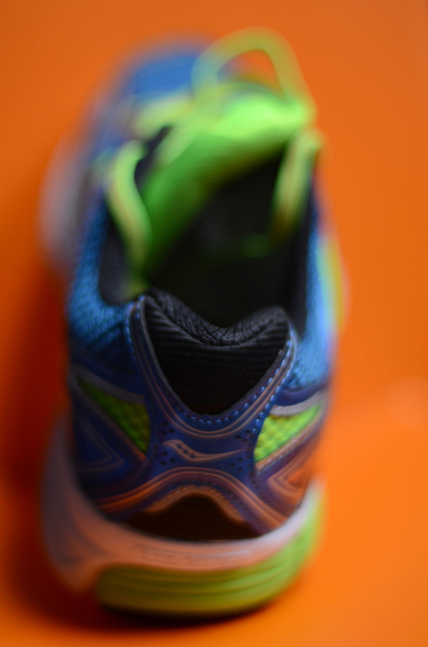 orange color, no people, selective focus, shoe, close-up, indoors, multi colored, day