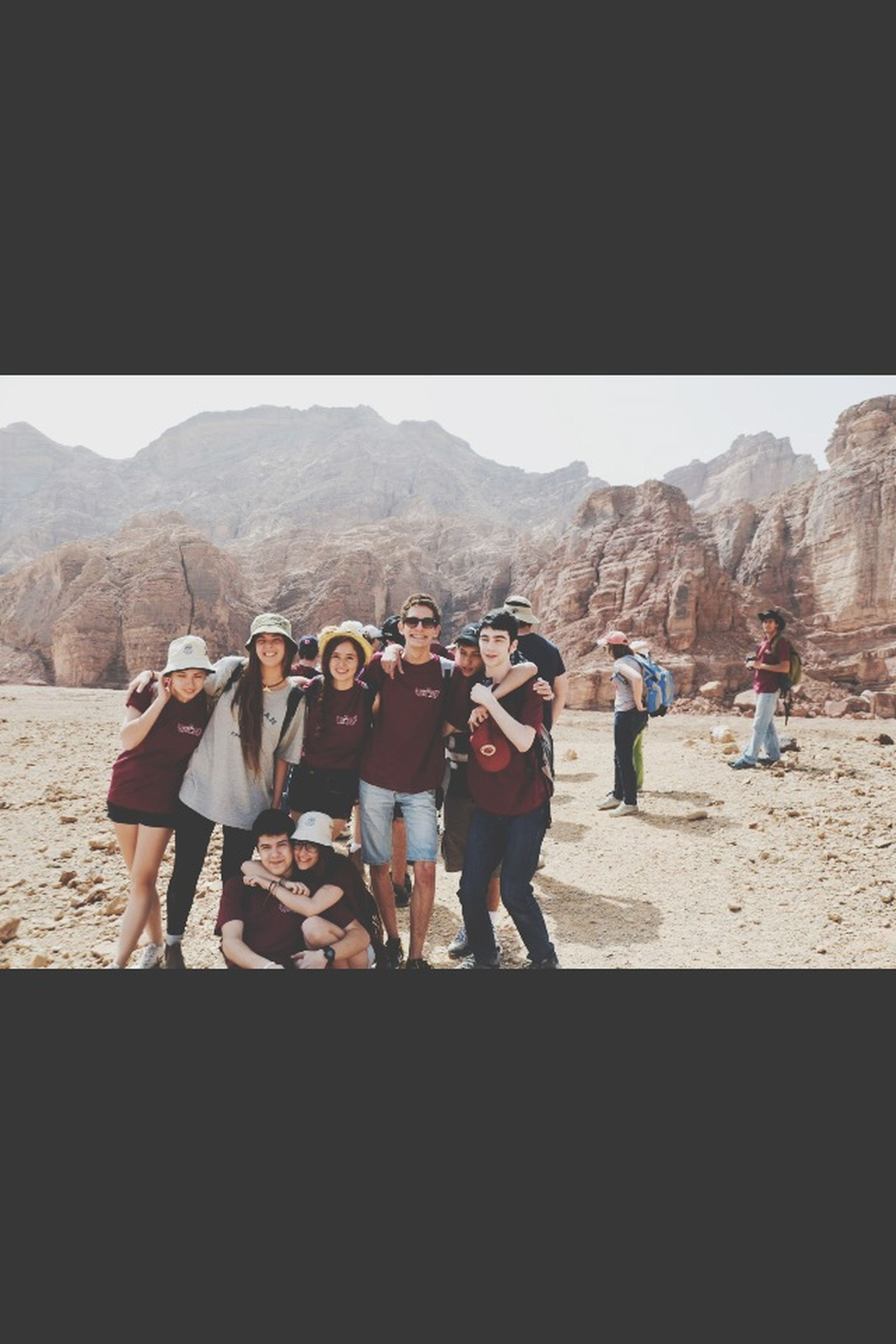 lifestyles, men, clear sky, person, leisure activity, mountain, large group of people, copy space, togetherness, full length, tourist, standing, landscape, rear view, tourism, vacations, travel, walking, casual clothing