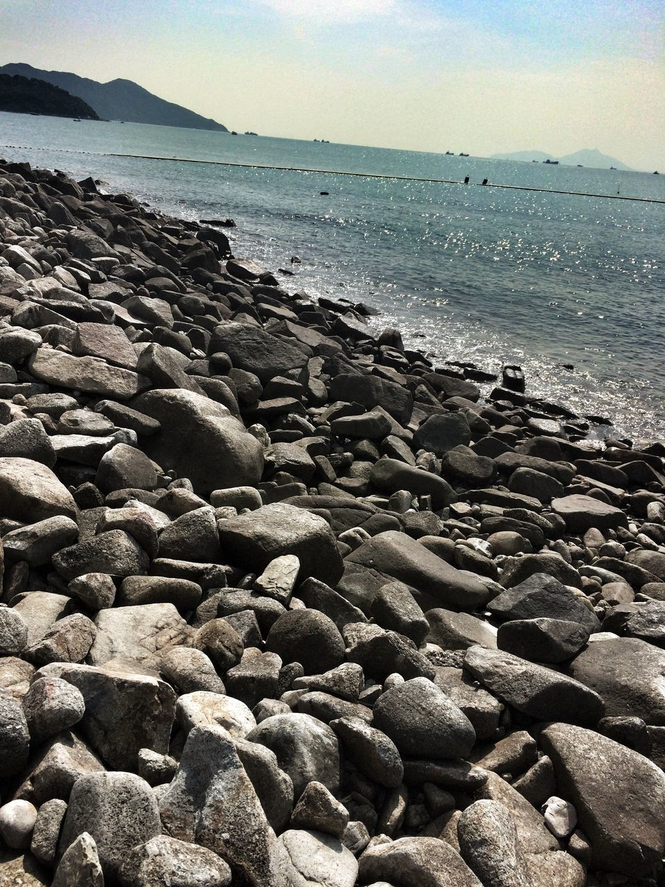Rocky Shore Of Sea Against Sky