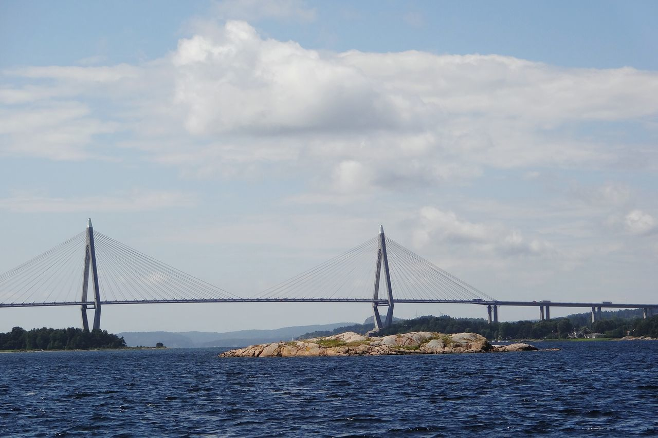 Bridge - Man Made Structure Connection Suspension Bridge Sea Built Structure Outdoors Tranquility Coastal Feature Tranquil Scene Scenics Brücke Sunny Day Udevalla Sweden Schweden Carbridge Sky And Clouds Colour Blue Seascape