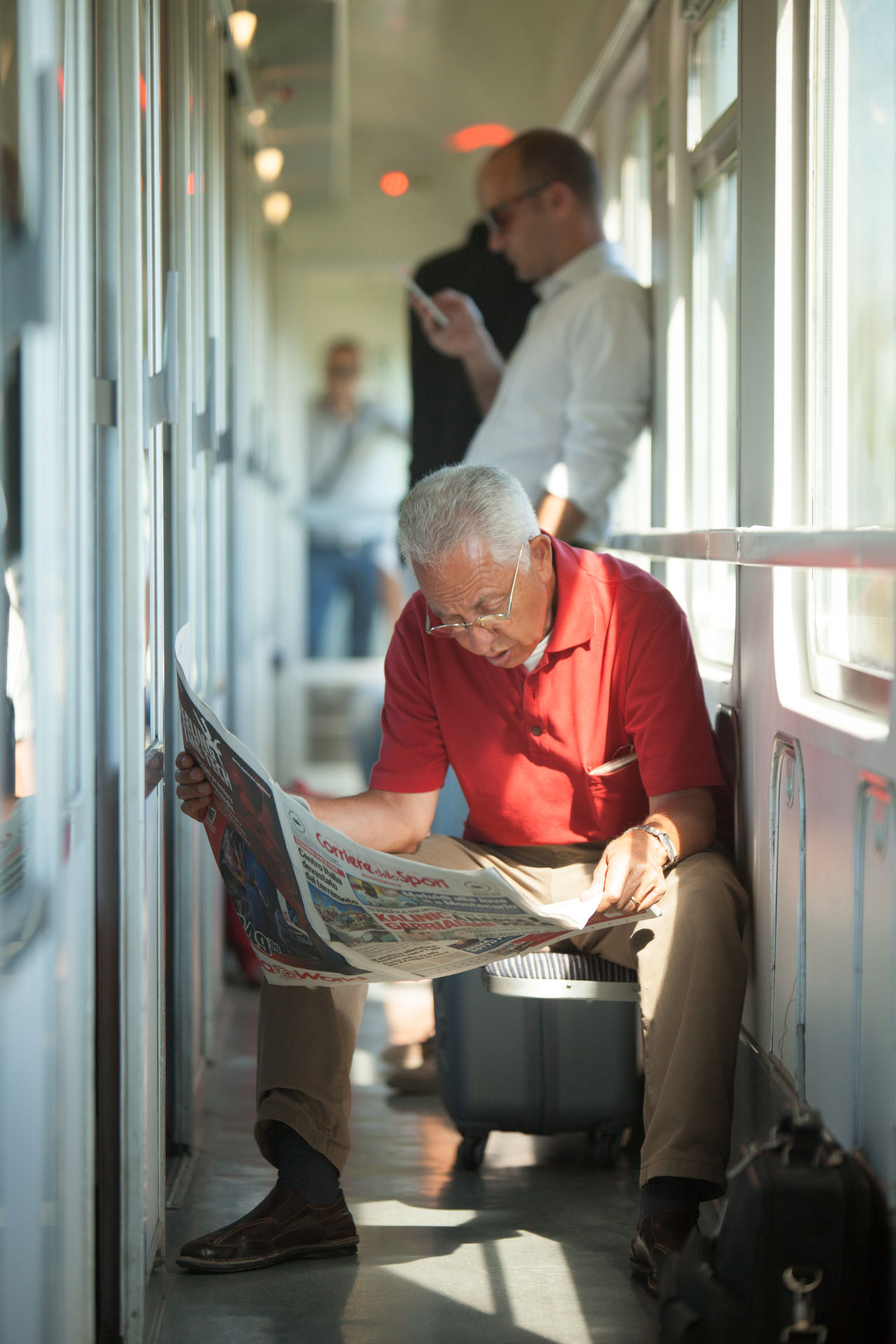 Newspaper against smartphone on a train Day Full Length Indoors  Mature Adult Mature Men Men Newspaper Real People Sitting Standing The Street Photographer - 2017 EyeEm Awards Two People Uniform Working Young Adult