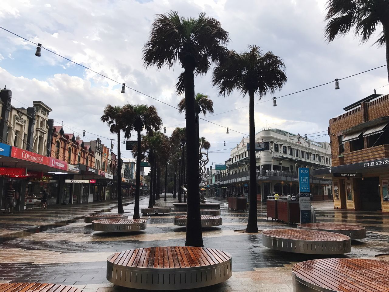 Tree Palm Tree Building Exterior Built Structure City Architecture Street Sky Outdoors Fountain Day No People Cloud - Sky Water Nature
