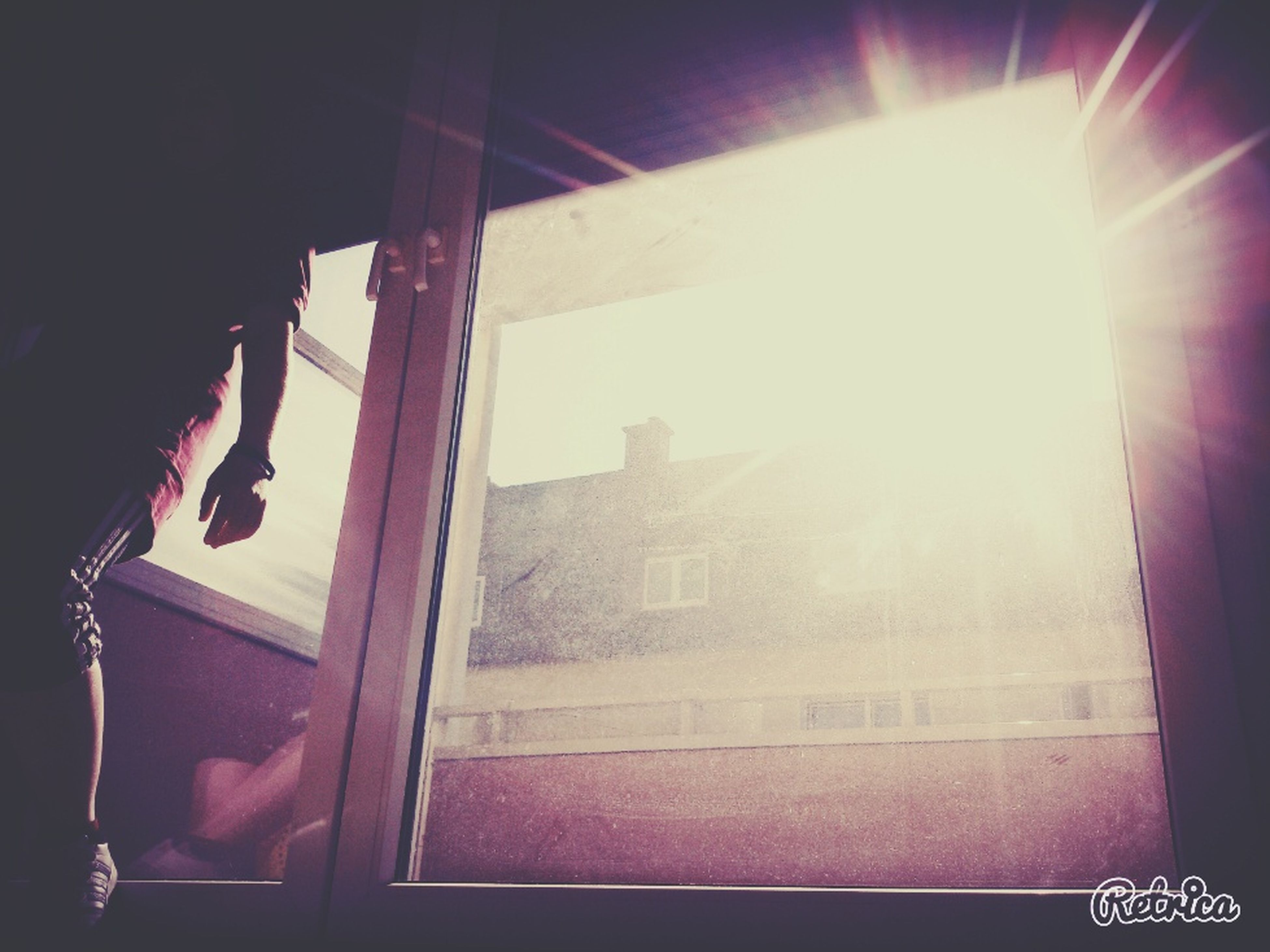 architecture, built structure, window, building exterior, indoors, sunbeam, sunlight, sun, lens flare, glass - material, building, low angle view, curtain, house, home interior, no people, day, wall - building feature, city, transparent