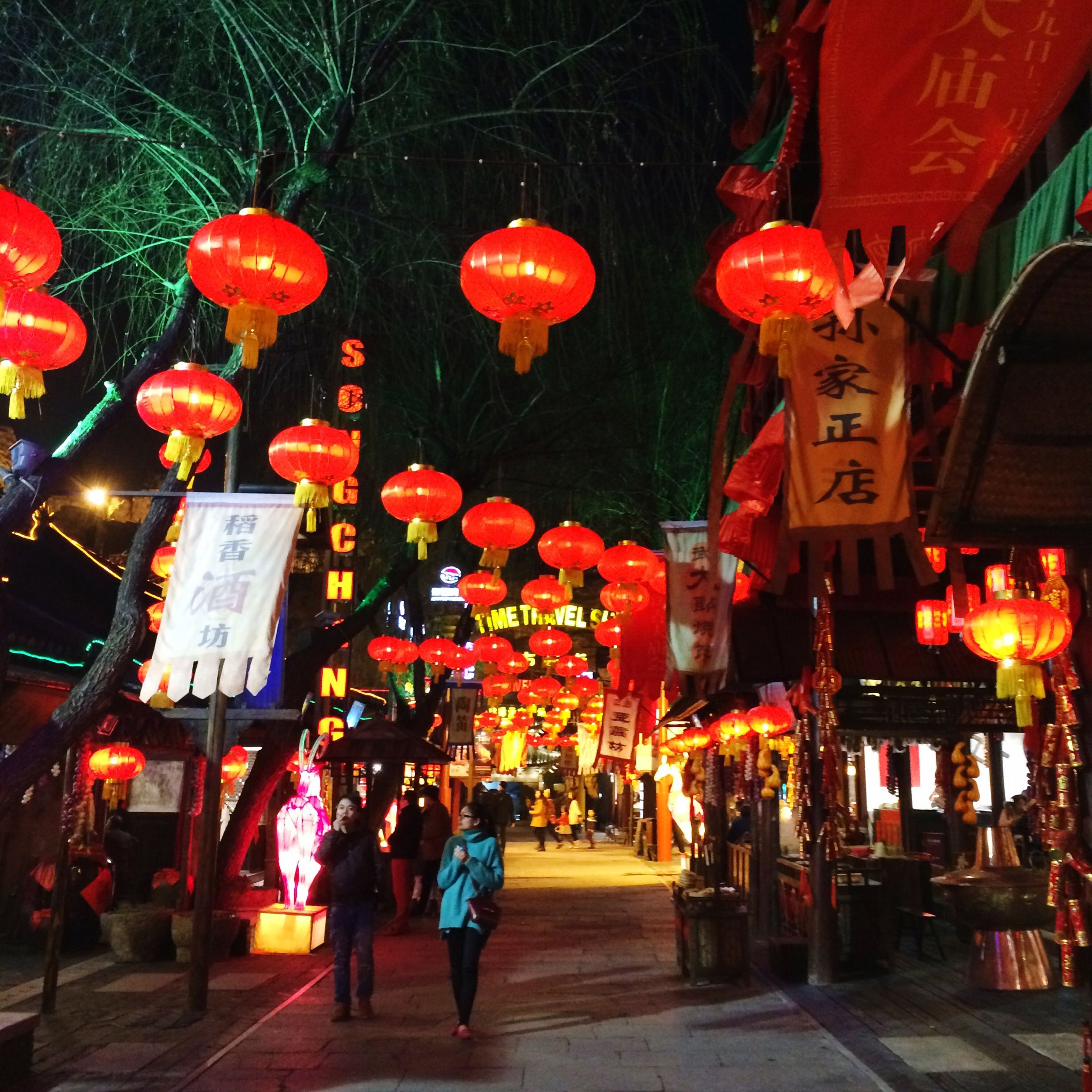 illuminated, night, men, lighting equipment, celebration, lantern, red, cultures, tradition, person, decoration, large group of people, hanging, lifestyles, leisure activity, culture, religion, traditional festival, built structure