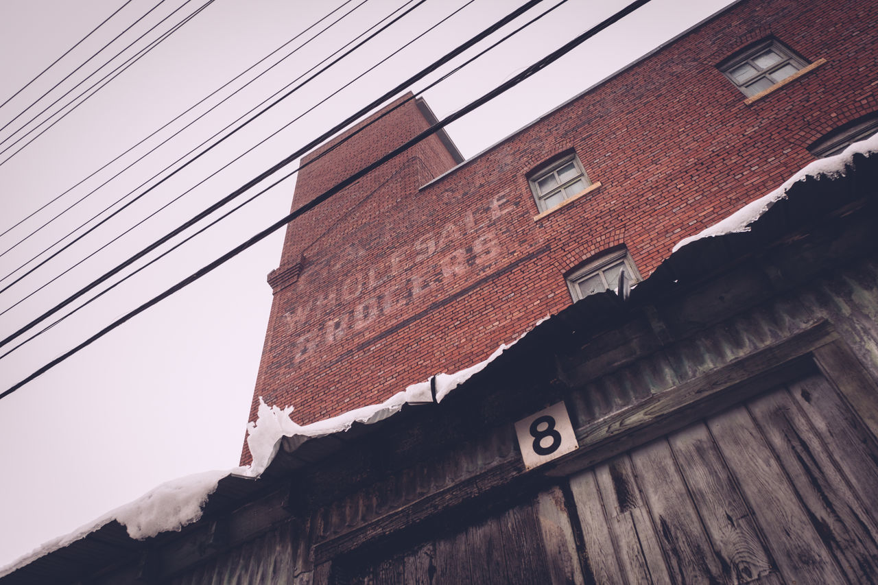 Architecture Building Exterior Built Structure Cable Day Electricity  Low Angle View No People Outdoors Power Line  Sky Snow