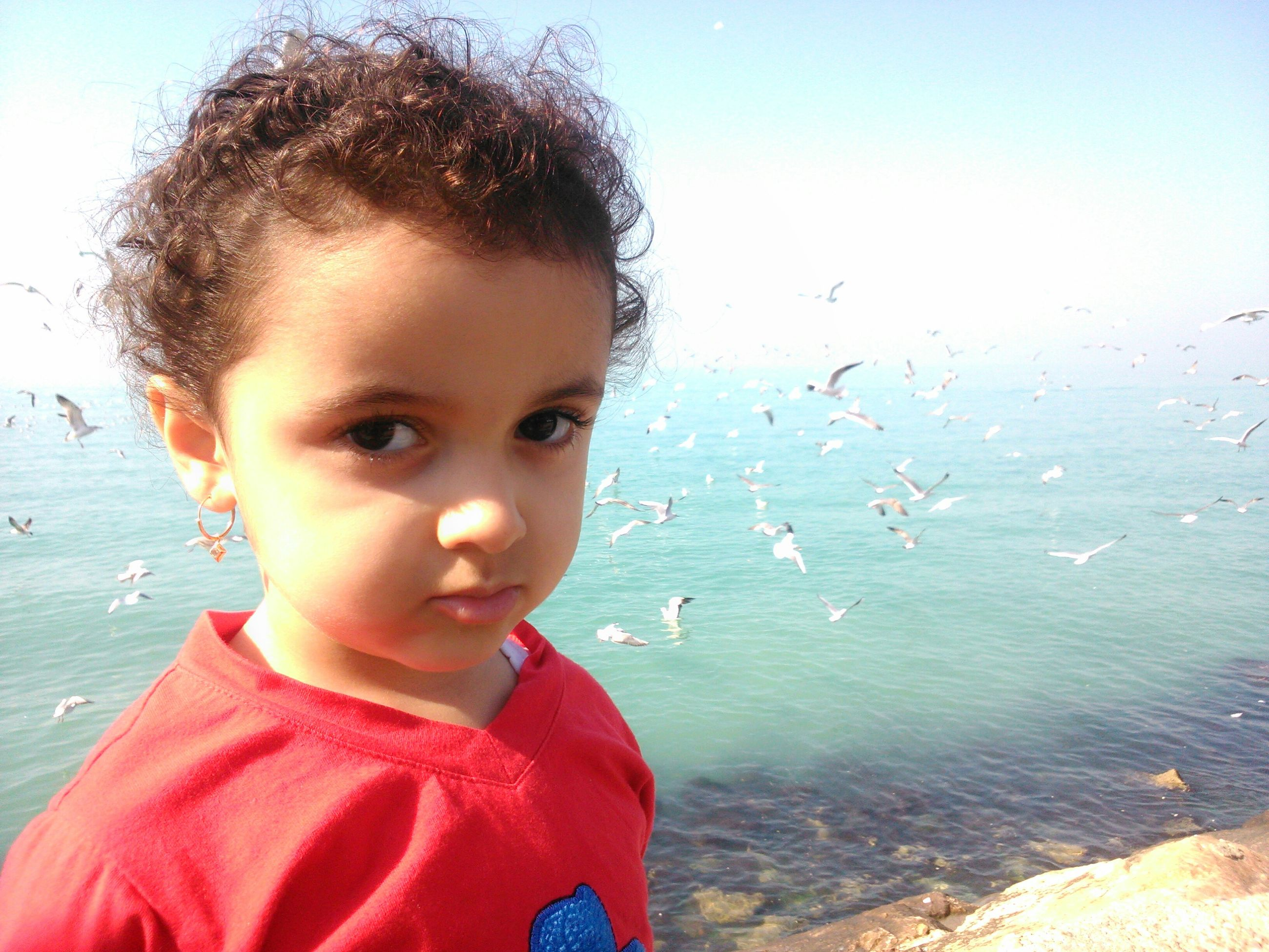 childhood, water, person, elementary age, innocence, cute, headshot, lifestyles, boys, leisure activity, looking at camera, girls, portrait, close-up, casual clothing, smiling, focus on foreground