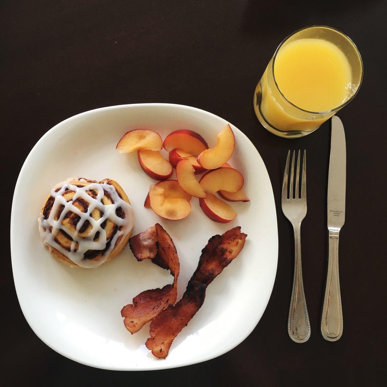 Breakfast Breakfast Breakfast Plate Bacon! Bacons Cinnamon Cinnamon Roll  Orange Juice  Plum Sliced Fruits