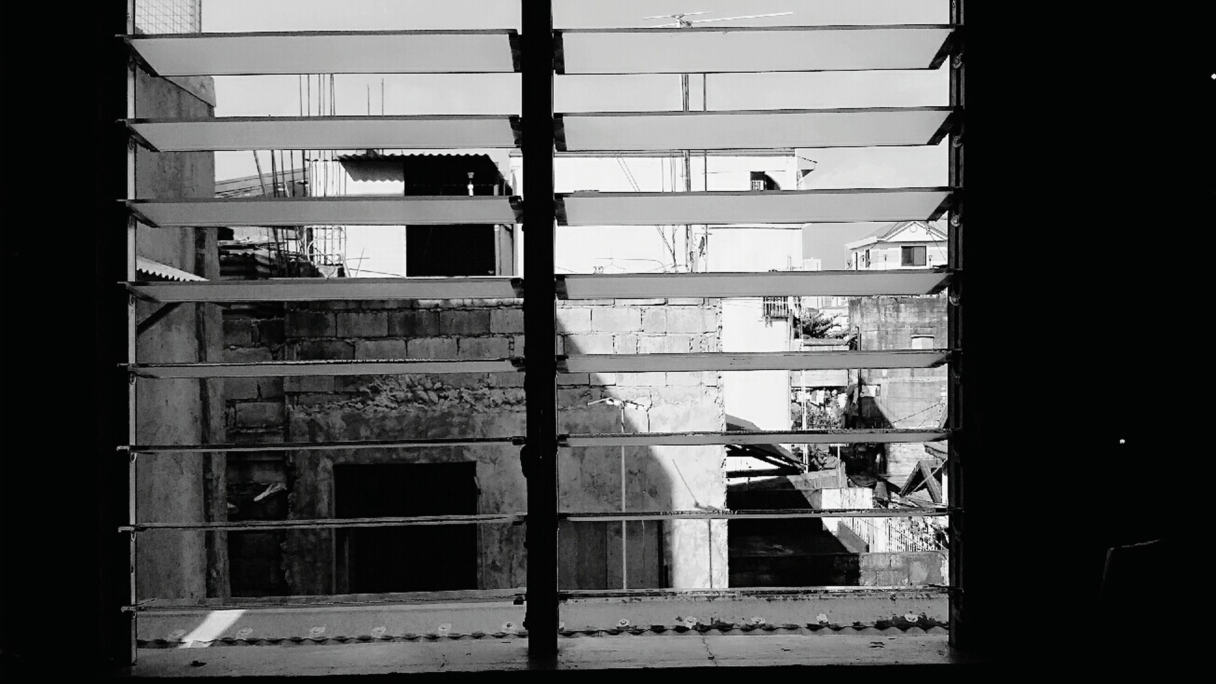 architecture, built structure, building exterior, window, building, city, residential building, residential structure, glass - material, day, house, indoors, exterior, no people, sunlight, shadow, abandoned, balcony, old