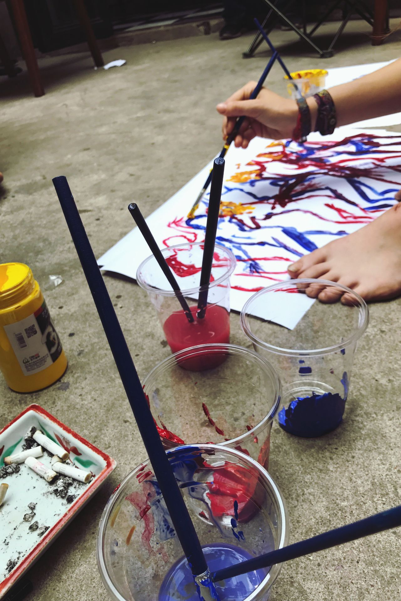 The colorful life of artists. Paintbrush One Person Skill  Palette Holding Artist Leisure Activity Real People Indoors  Childhood Painter - Artist Paint Can Workshop Close-up Human Body Part People Day Adult