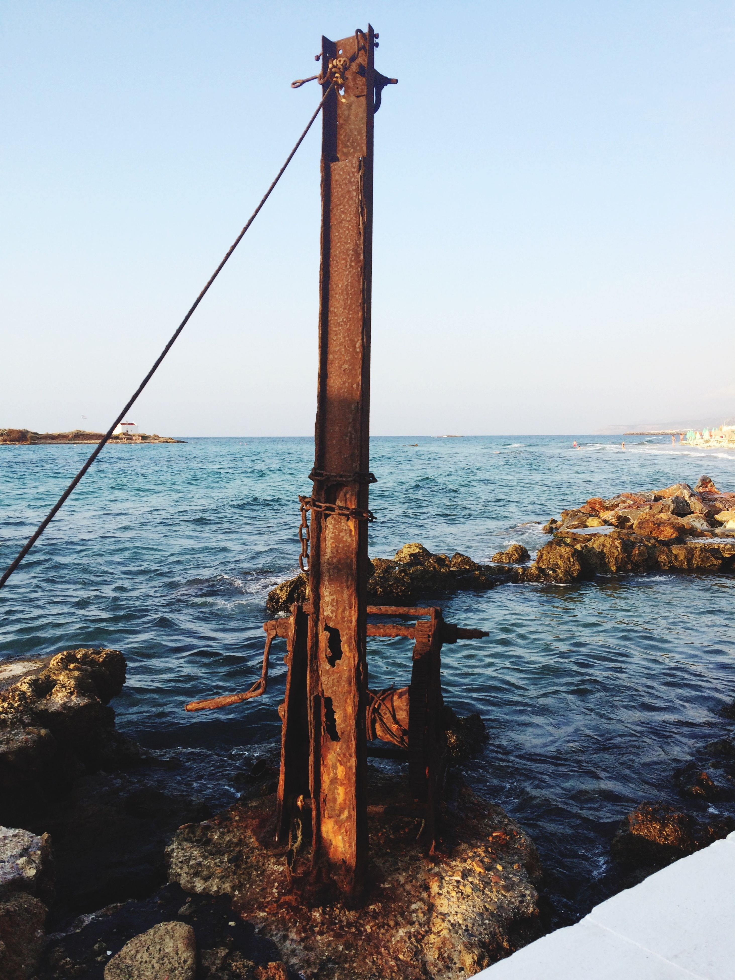 water, sea, horizon over water, clear sky, tranquility, tranquil scene, pier, scenics, nature, wood - material, copy space, beauty in nature, day, sky, idyllic, outdoors, rock - object, remote, no people, blue