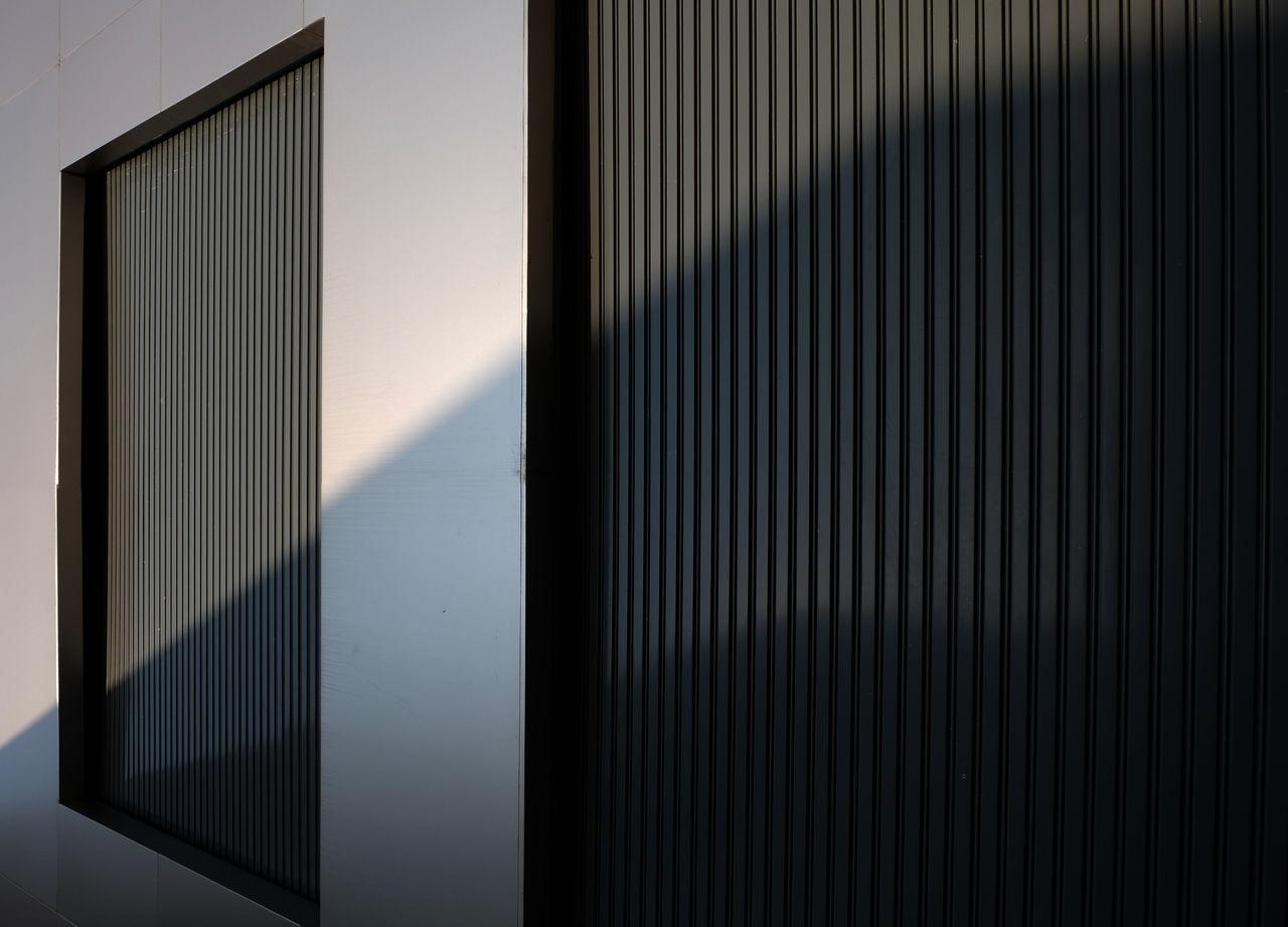 Aluminum Closed Corrugated Iron Day Metal No People Outdoors Radiator Sliding Door Sun Light Sunny The City Light Wall - Building Feature