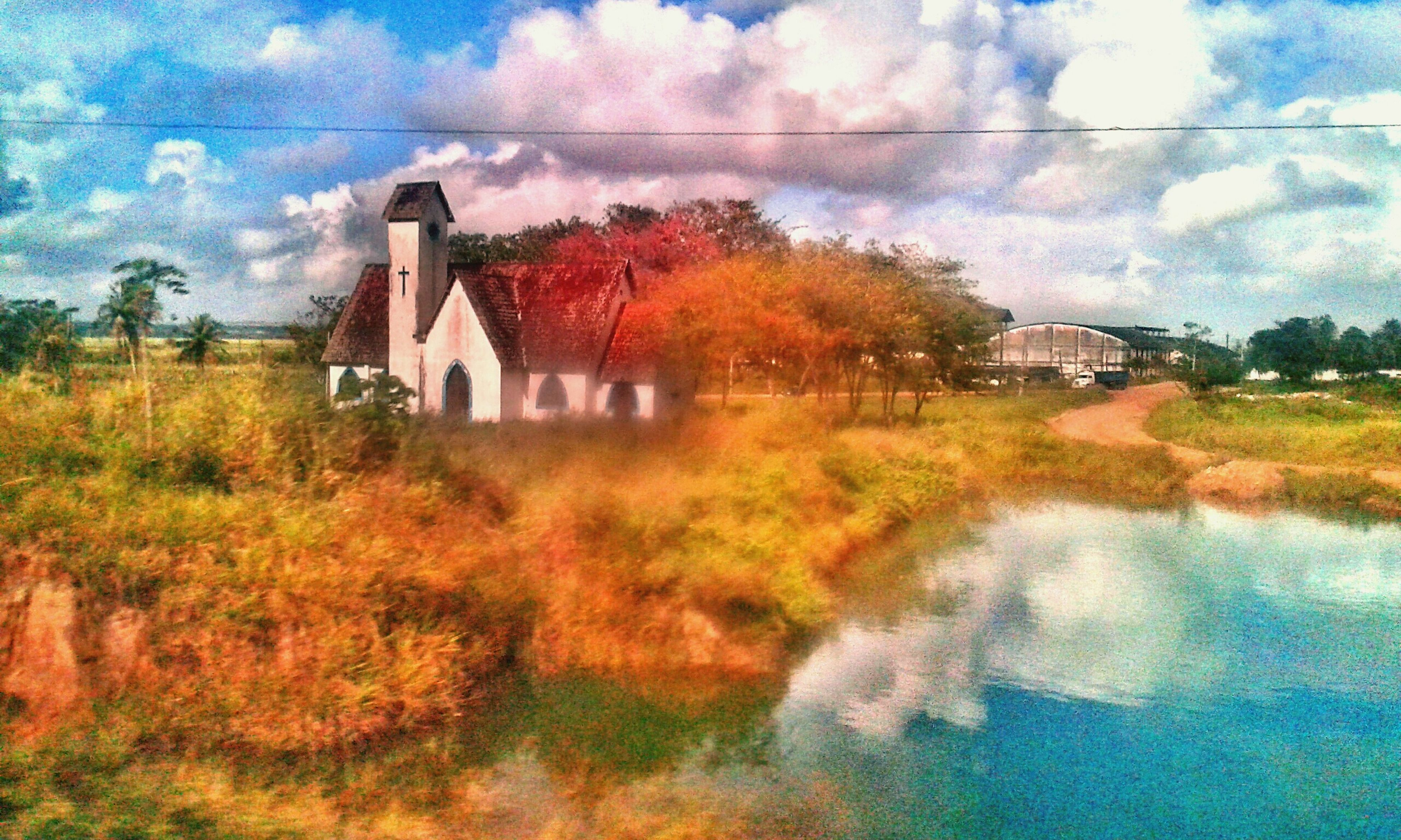 architecture, building exterior, built structure, sky, cloud - sky, tree, reflection, water, grass, house, cloud, nature, puddle, field, cloudy, outdoors, no people, growth, residential structure, day