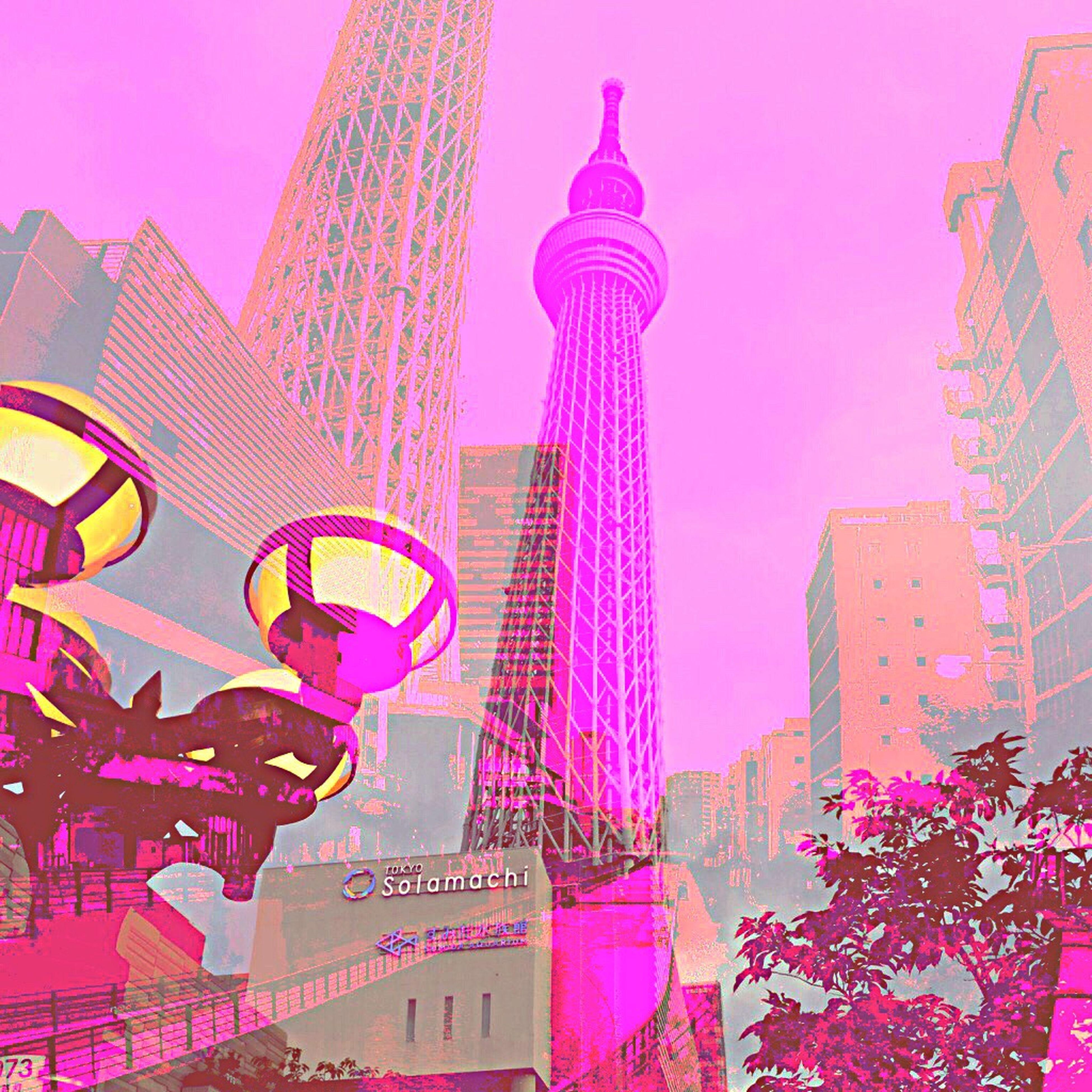 architecture, built structure, building exterior, low angle view, tall - high, tower, famous place, city, international landmark, capital cities, travel destinations, communication, sky, tourism, arts culture and entertainment, amusement park ride, clear sky, modern, travel, amusement park