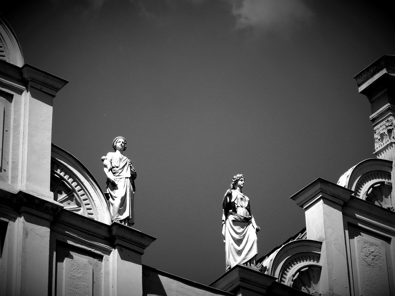 Low Angle View Of Statues On Historic Building Against Sky