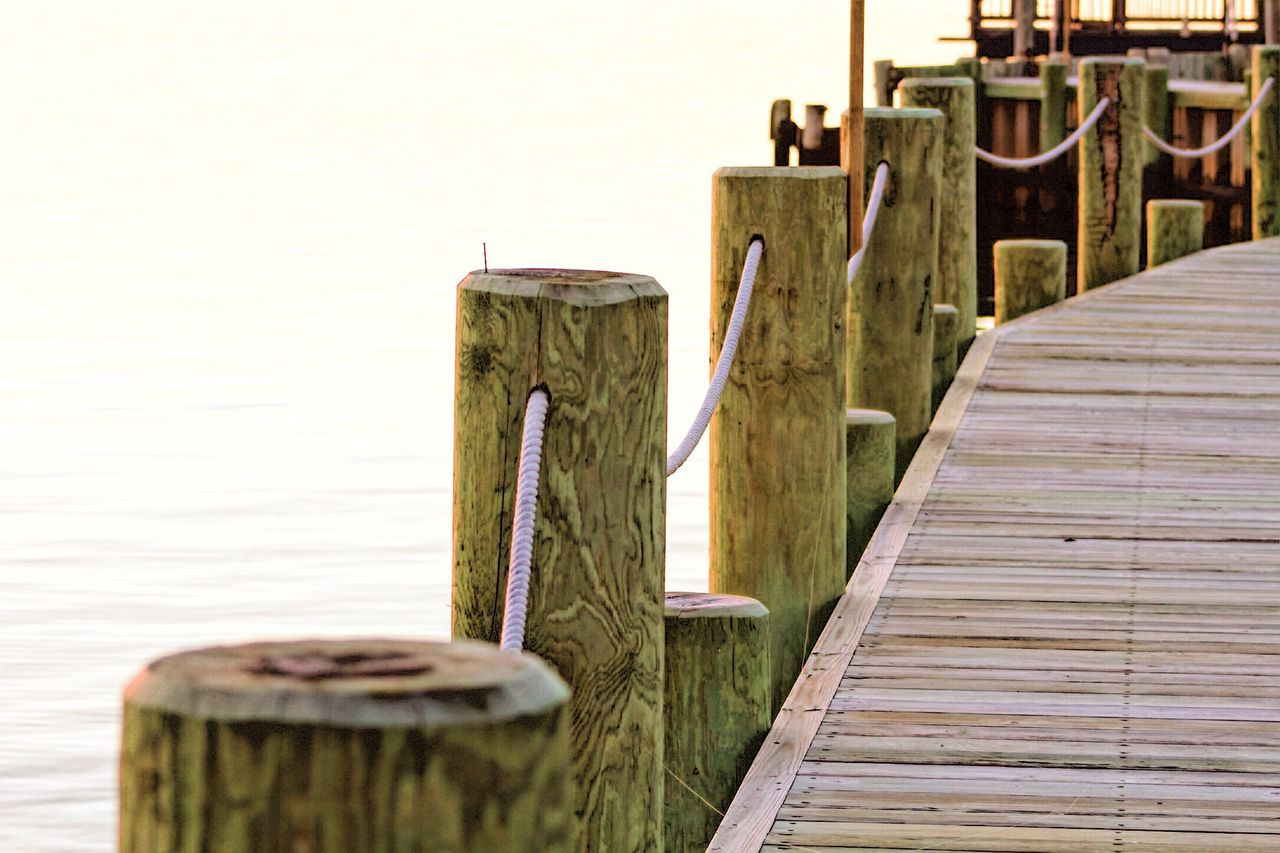 Wooden Jetty On Pier Over Sea