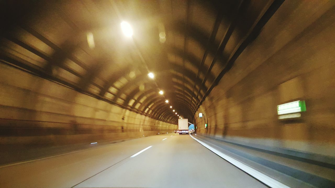 illuminated, transportation, the way forward, tunnel, road, no people, indoors, speed, night, architecture