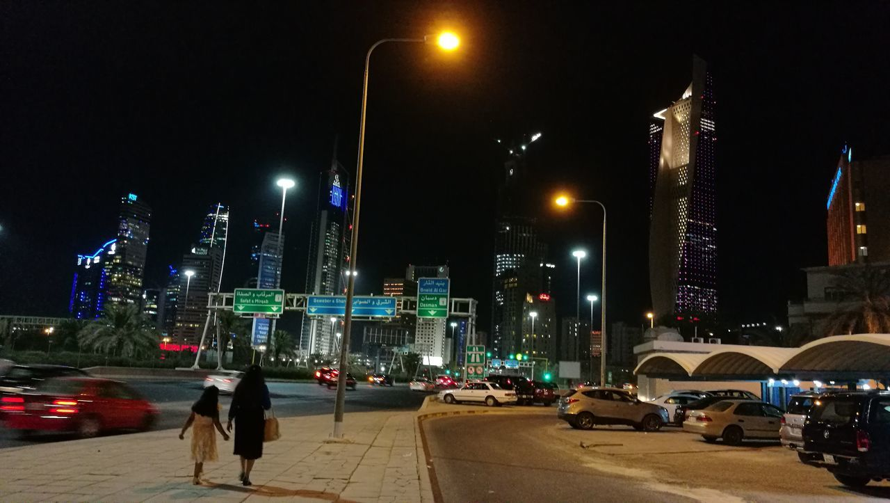 My Year My View Street Light Illuminated City Life Architecture Embrace Urban Life Purist In Photography No Edits No Filters Nightlife Urban Photography Mother And Daughter Togetherness Available Light No Edits Kuwait Tonight Kuwait City Transportation Outdoors Sreet Photography Night Photography