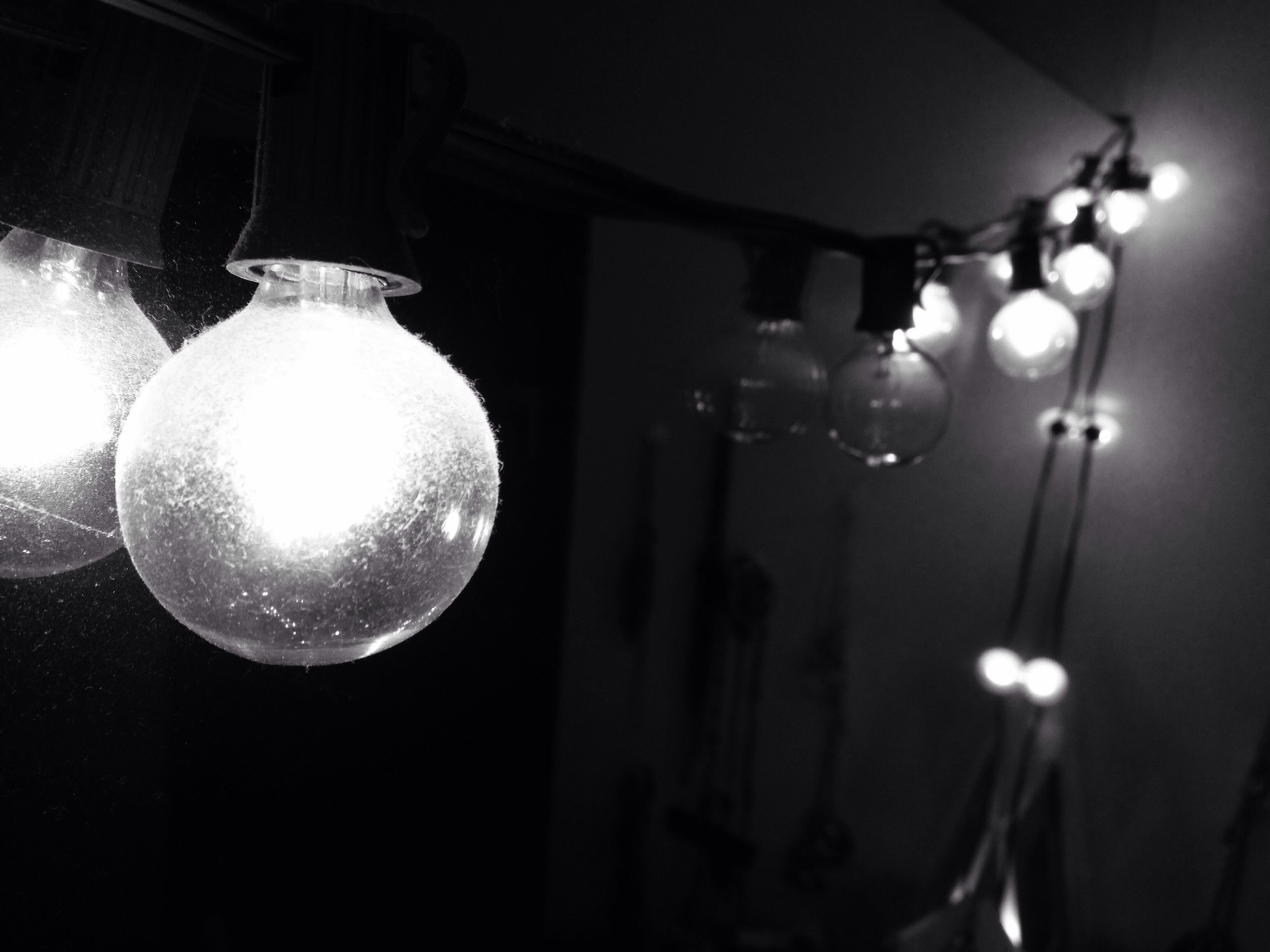 lighting equipment, illuminated, hanging, indoors, electricity, light bulb, electric lamp, decoration, electric light, low angle view, close-up, focus on foreground, home interior, chandelier, no people, light - natural phenomenon, night, ceiling, decor, lit