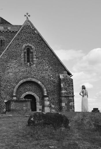 Bridesmaid Church Low Angle View Outdoors Outside Place Of Worship Religion Waiting Wedding Wedding Photography Wedding Day WeddingphotographyBlack And White Photography Blackandwhite Photography Leftbehind Wedding Photos Weddingparty