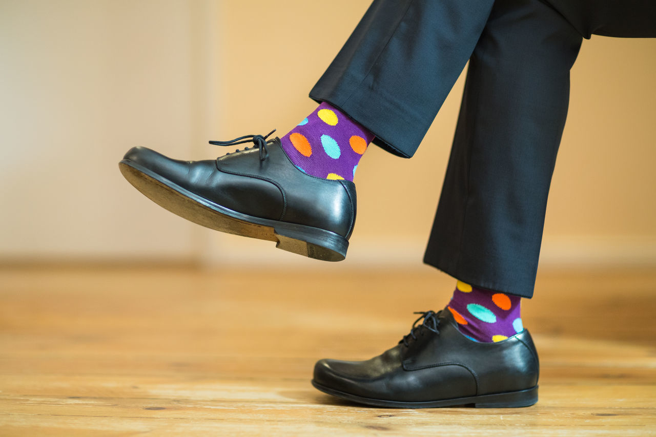 Black Shoes Business Two Is Better Than One Colorful Colourful Dotted Footwear Human Body Part Human Foot Human Leg Individuality Leather Shoes Low Section Men Part Of Colour Of Life Real People Shoe Sitting Socks Suit Trousers Vibrant Colors Vibrant Colours Fashion Fashionable