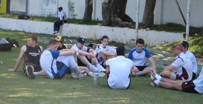 Durham coach, John Lewis talks tactics with Durham Academy players in some welcome shade Cricketers