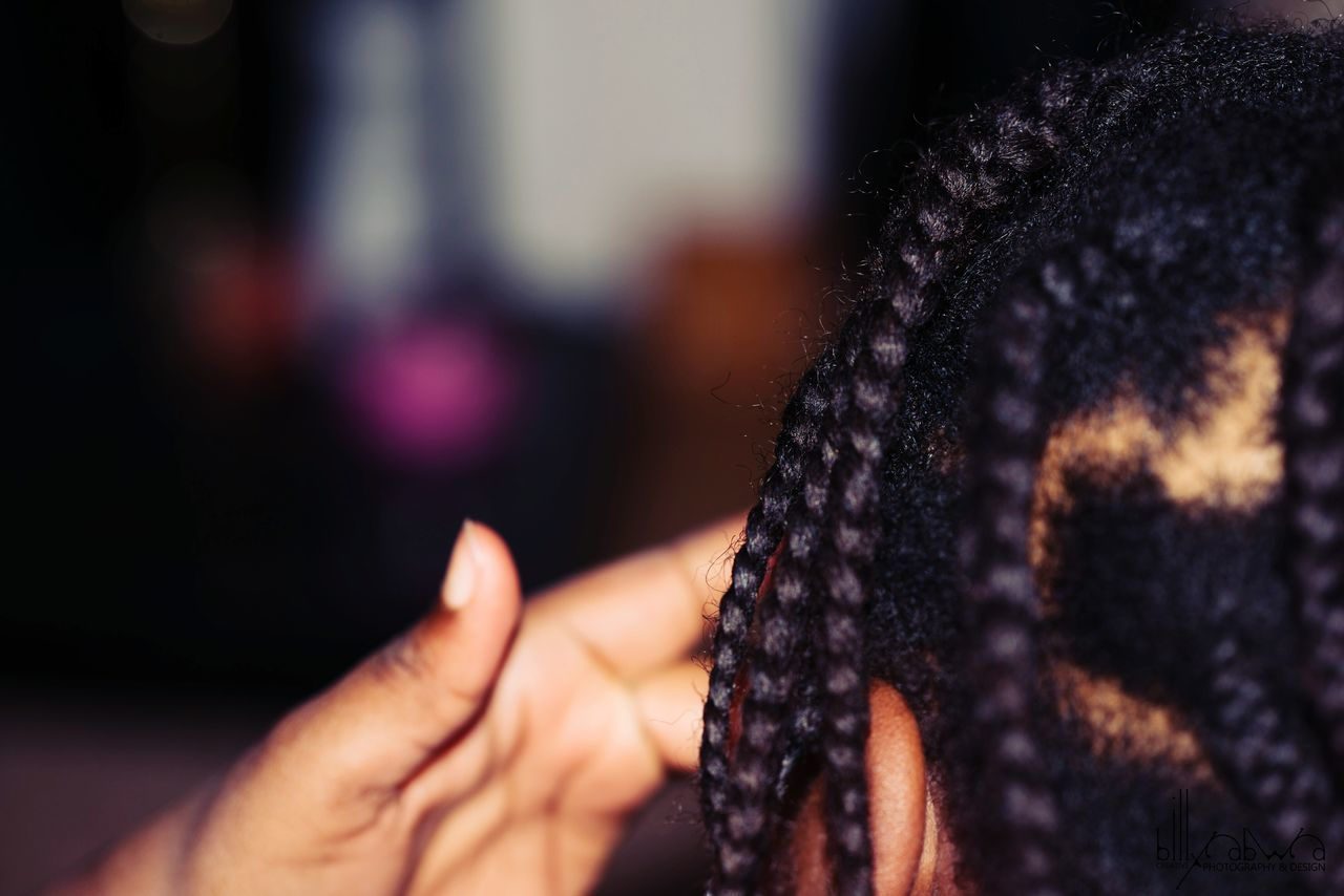 Cropped Image Of Person With Dreadlocks