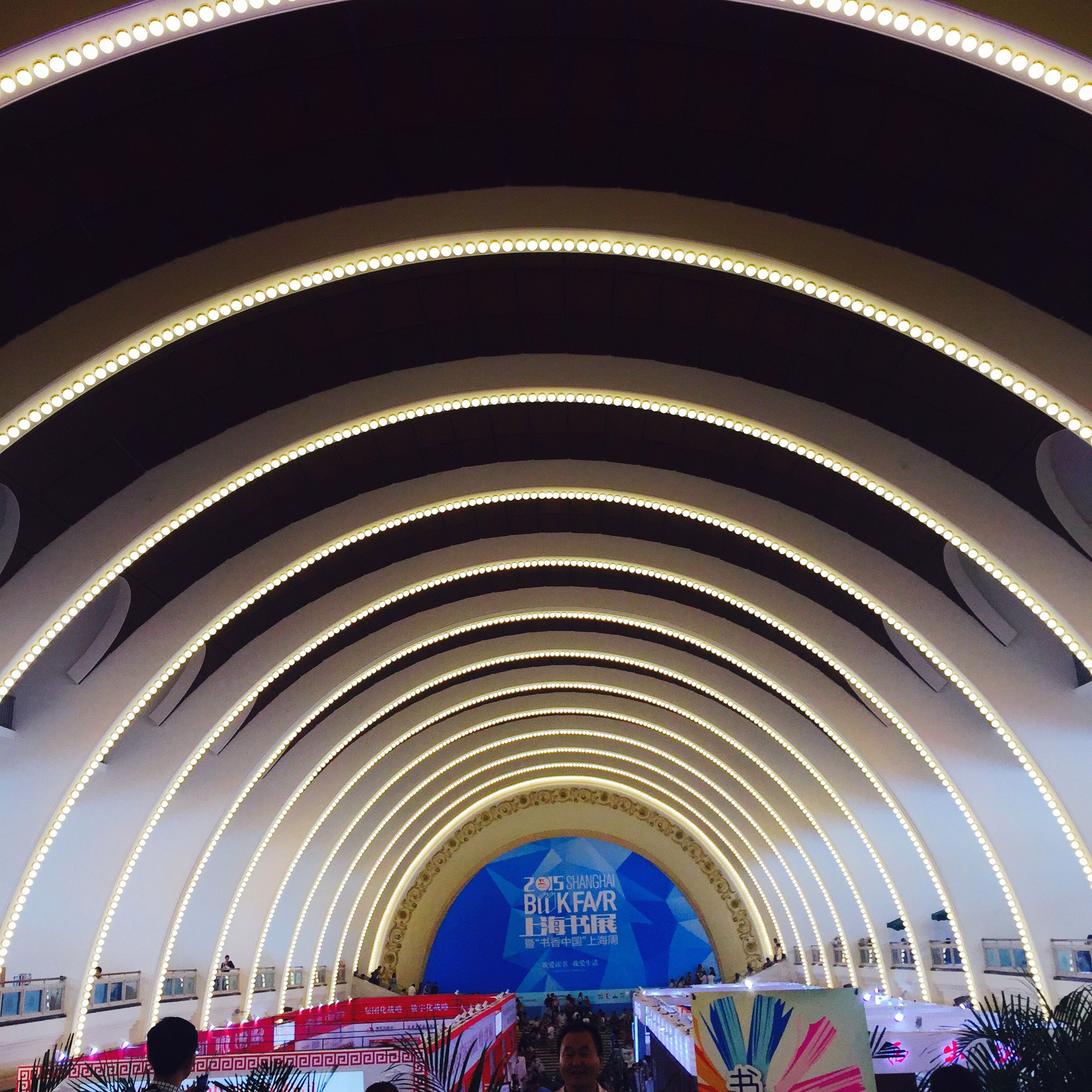 indoors, arch, architecture, built structure, large group of people, person, men, travel, lifestyles, modern, illuminated, low angle view, ceiling, leisure activity, transportation, escalator, travel destinations, incidental people, steps