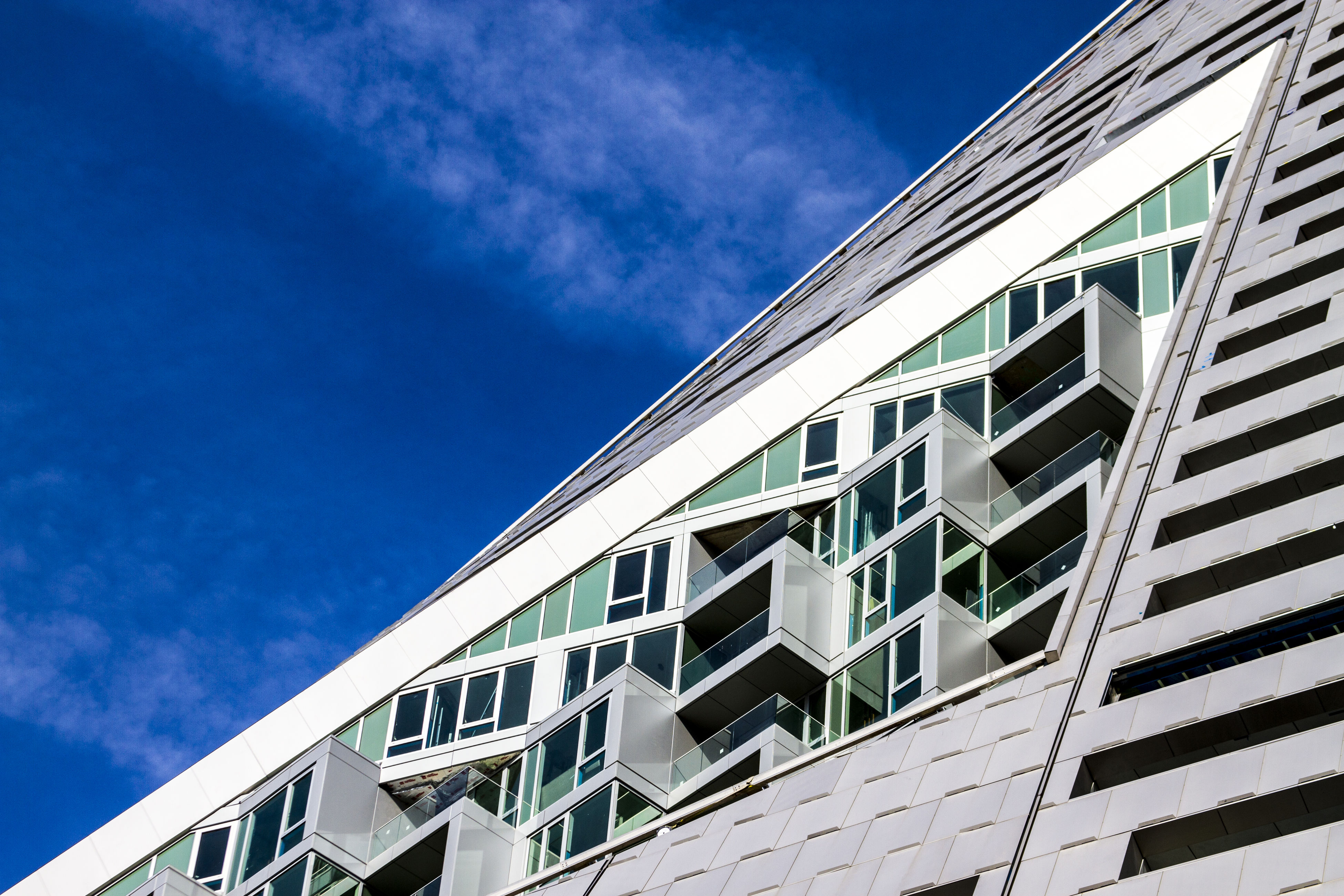 architecture, building exterior, built structure, low angle view, blue, window, sky, building, modern, city, office building, day, residential structure, glass - material, reflection, residential building, cloud, outdoors, no people, repetition