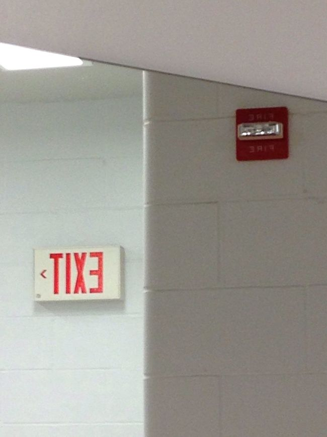 Fire Red Exit Sign Indoors  Close-up Emergency Equipment No People Text Illuminated Communication Text Architecture Day