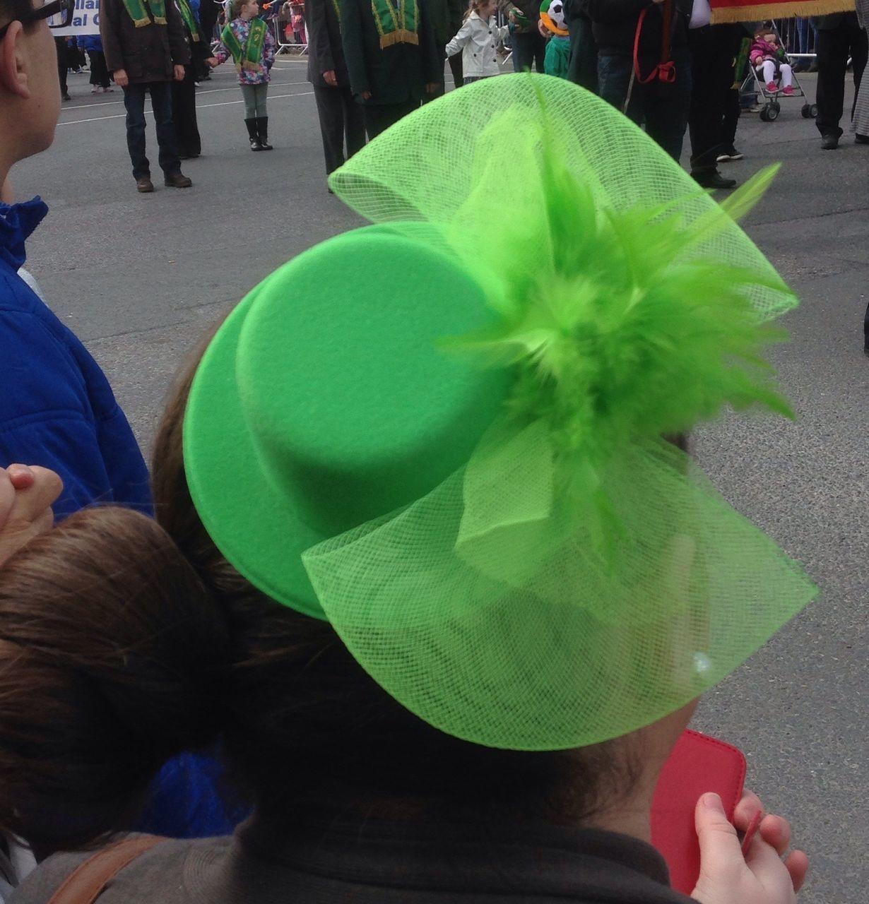 Rear View Of Woman Wearing Green Hat On Street