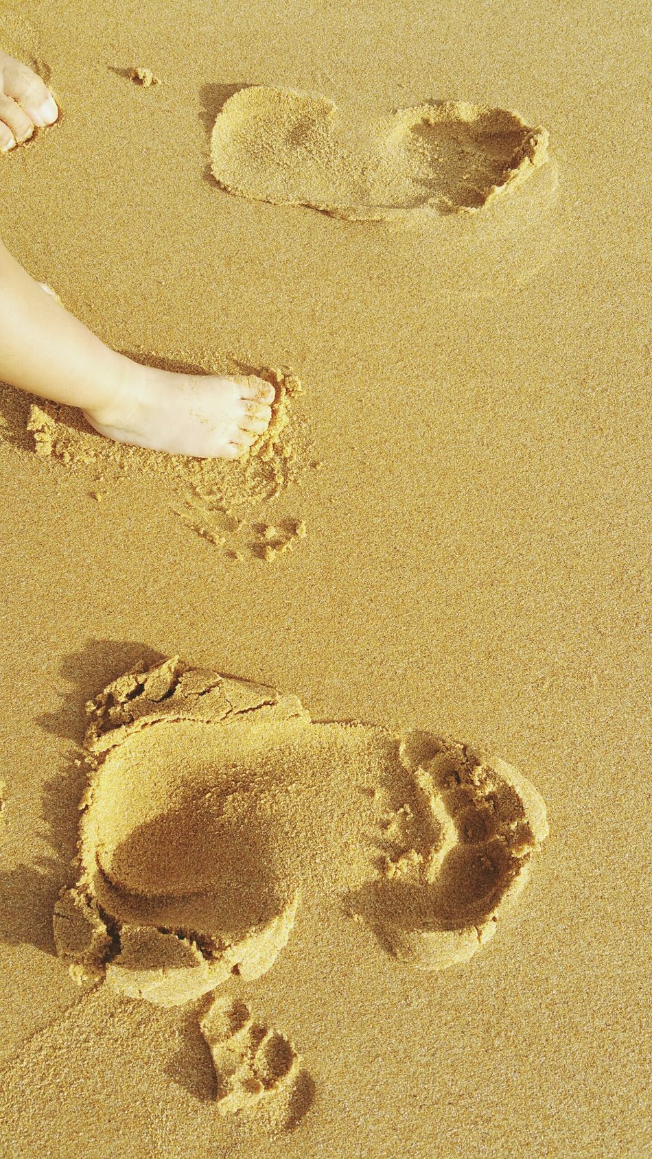 Barefoot and loving his first beach experience Firsts Footprints In The Sand FamilyTime Familytrip