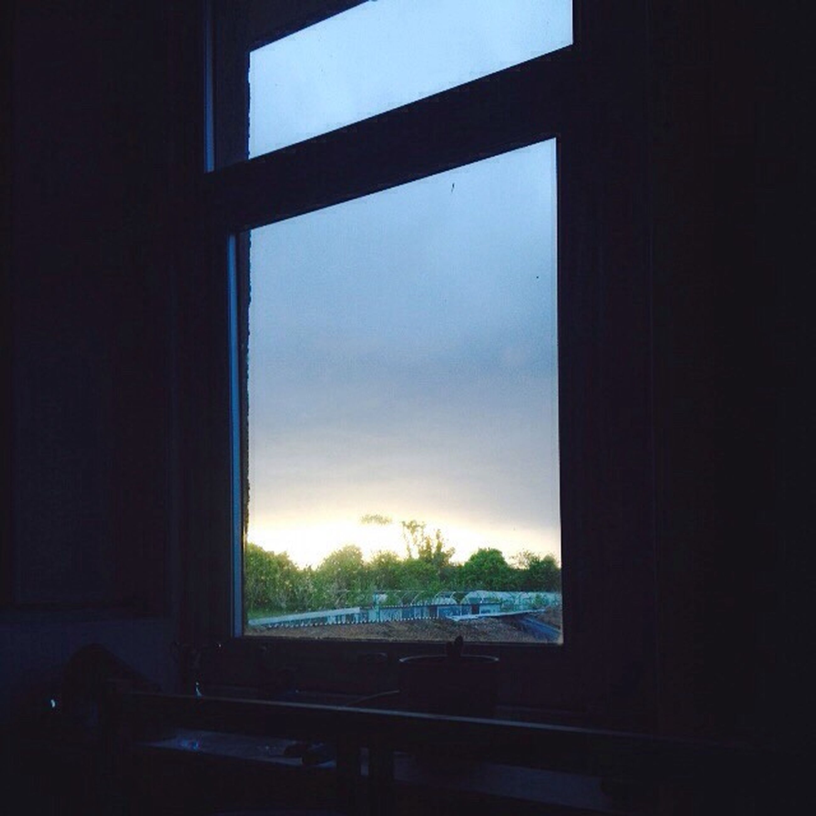 window, indoors, glass - material, transparent, sky, silhouette, looking through window, sunset, home interior, house, tree, built structure, dark, nature, curtain, cloud, cloud - sky, architecture, no people, window sill