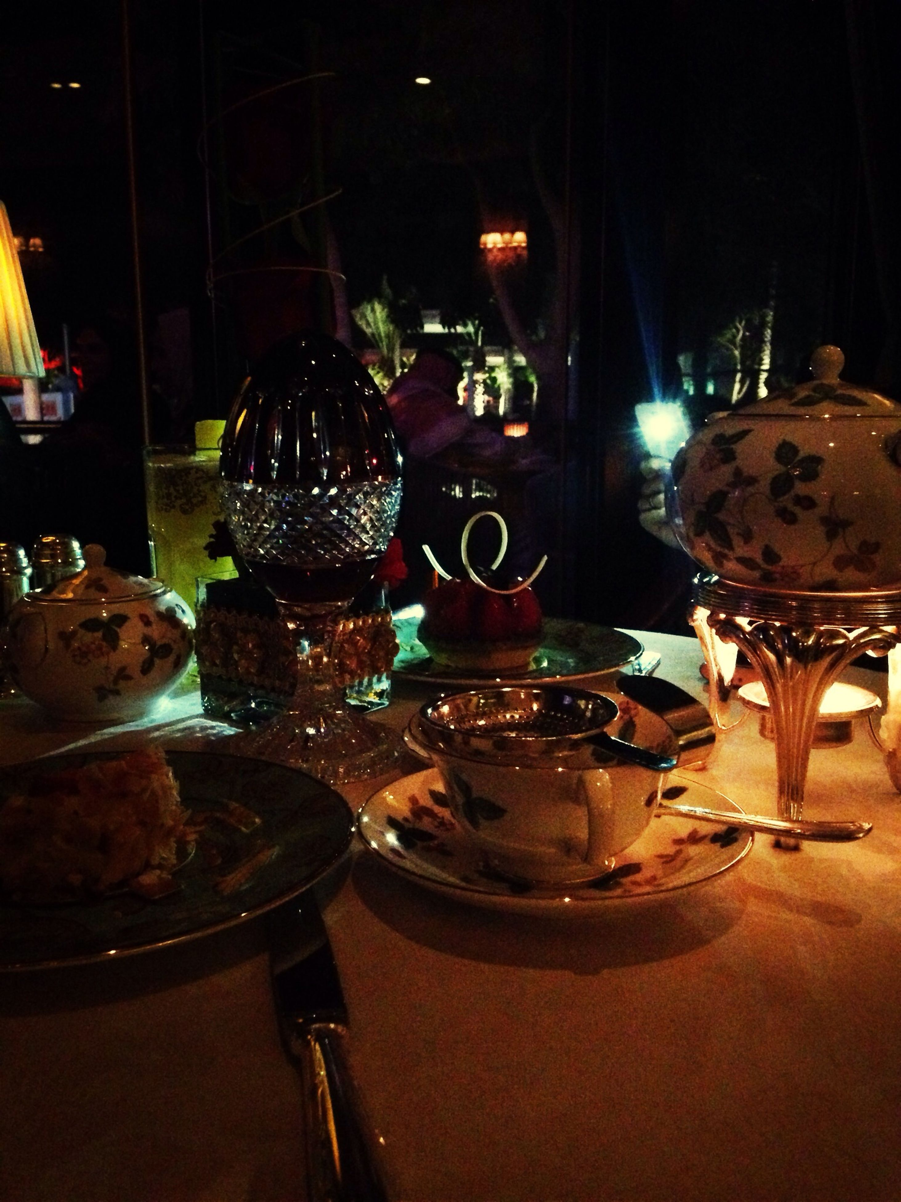 indoors, still life, table, close-up, illuminated, glass - material, night, metal, no people, food and drink, decoration, focus on foreground, container, antique, variation, home interior, old-fashioned, transparent, lighting equipment, restaurant