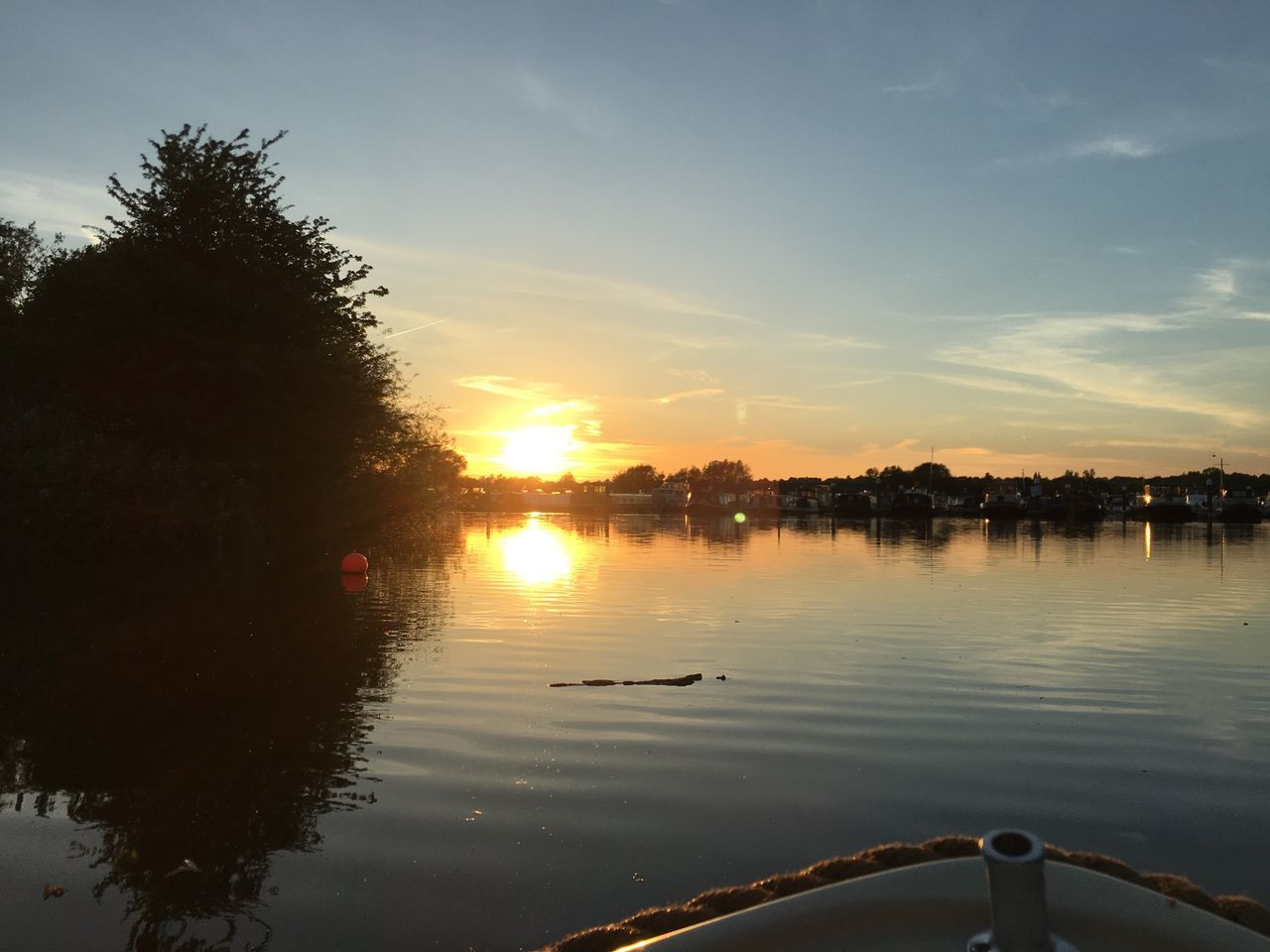 water, sunset, reflection, nature, beauty in nature, scenics, sky, tranquil scene, no people, outdoors, sun, silhouette, nautical vessel, lake, tree, day