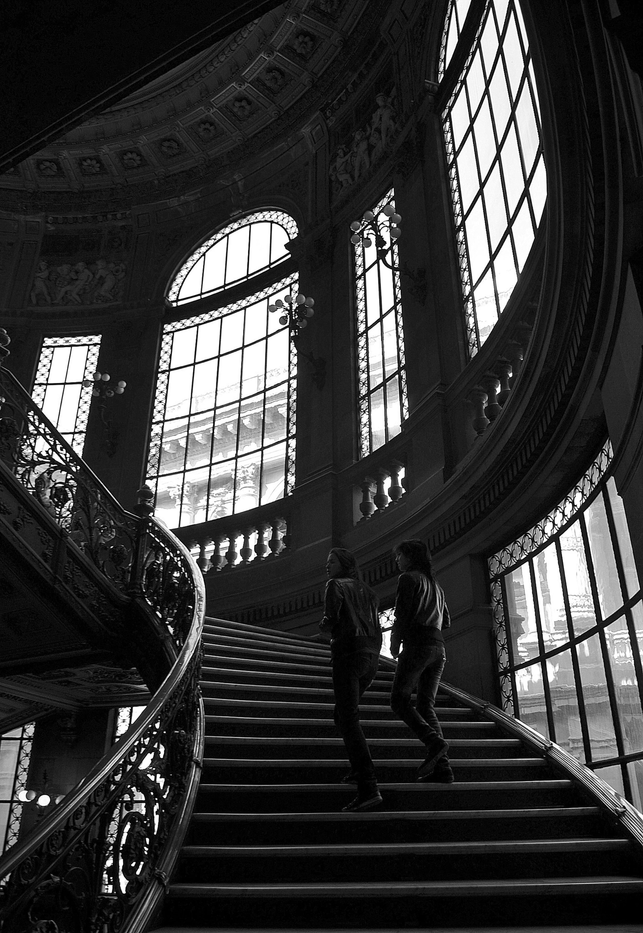 indoors, steps, architecture, steps and staircases, built structure, staircase, arch, railing, lifestyles, men, low angle view, stairs, window, person, leisure activity, place of worship, history, standing