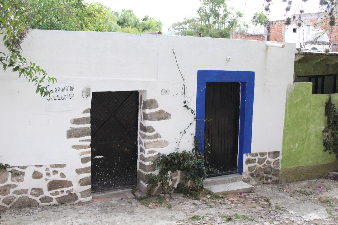 built structure, architecture, building exterior, door, outdoors, day, tree, doorway, no people, open door