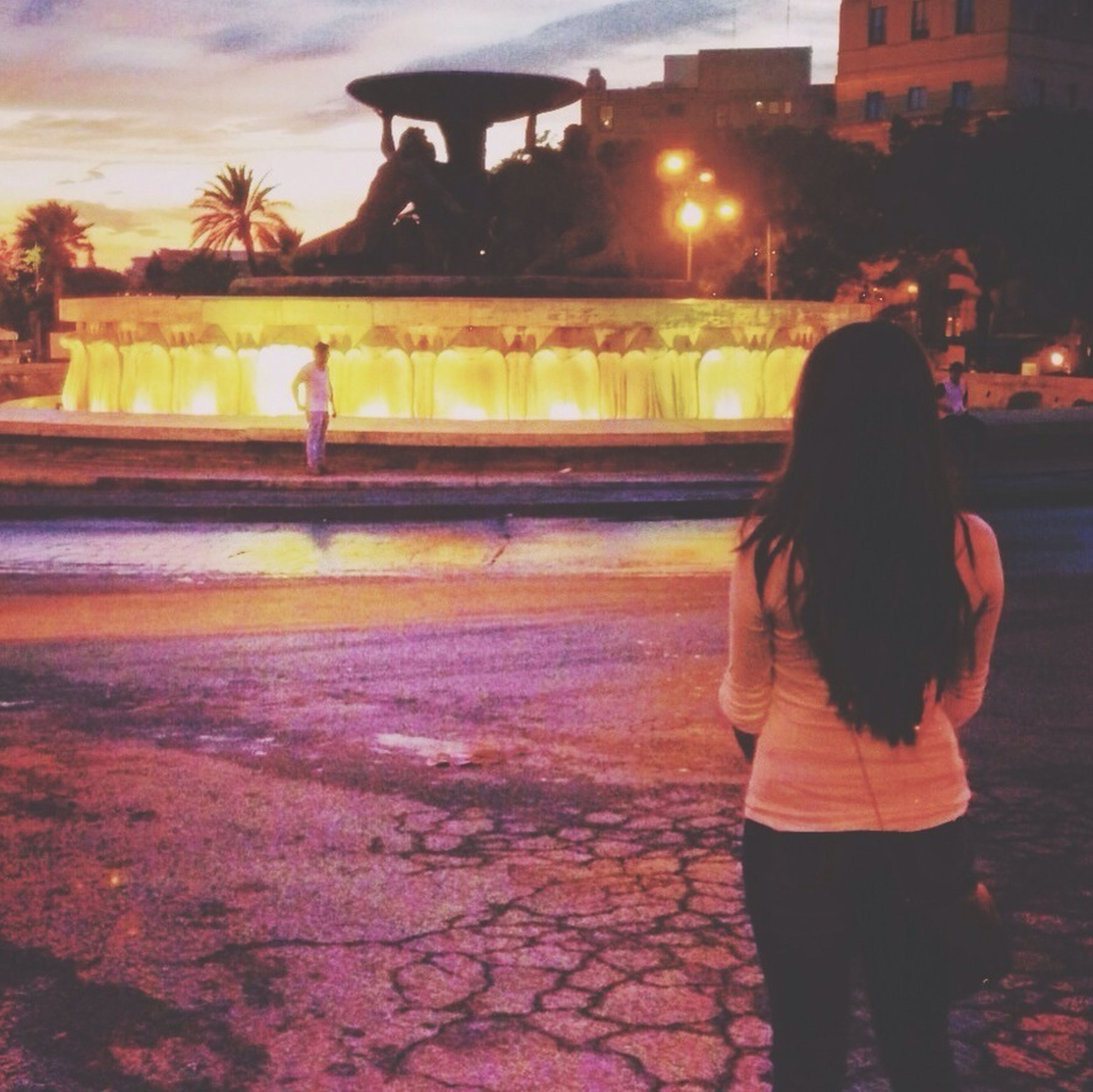 lifestyles, leisure activity, building exterior, full length, standing, casual clothing, person, rear view, architecture, built structure, illuminated, night, girls, water, sunset, walking, togetherness