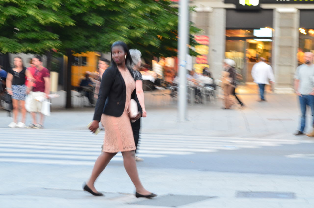 blurred motion, walking, real people, one person, full length, motion, leisure activity, lifestyles, young women, women, outdoors, young adult, day, people
