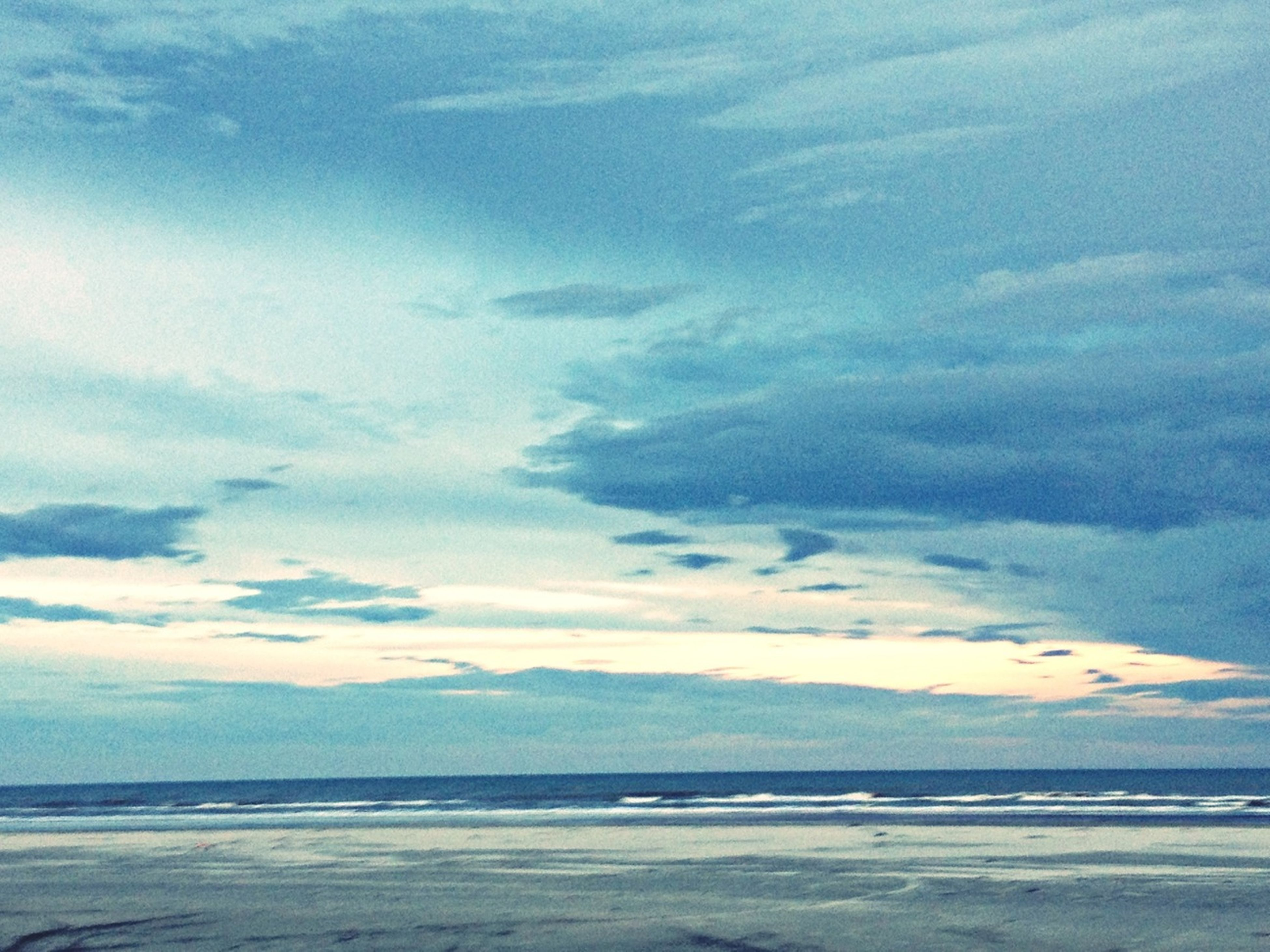 sea, beach, water, tranquil scene, sky, tranquility, scenics, shore, beauty in nature, sand, horizon over water, nature, cloud - sky, idyllic, cloud, coastline, cloudy, remote, non-urban scene, outdoors