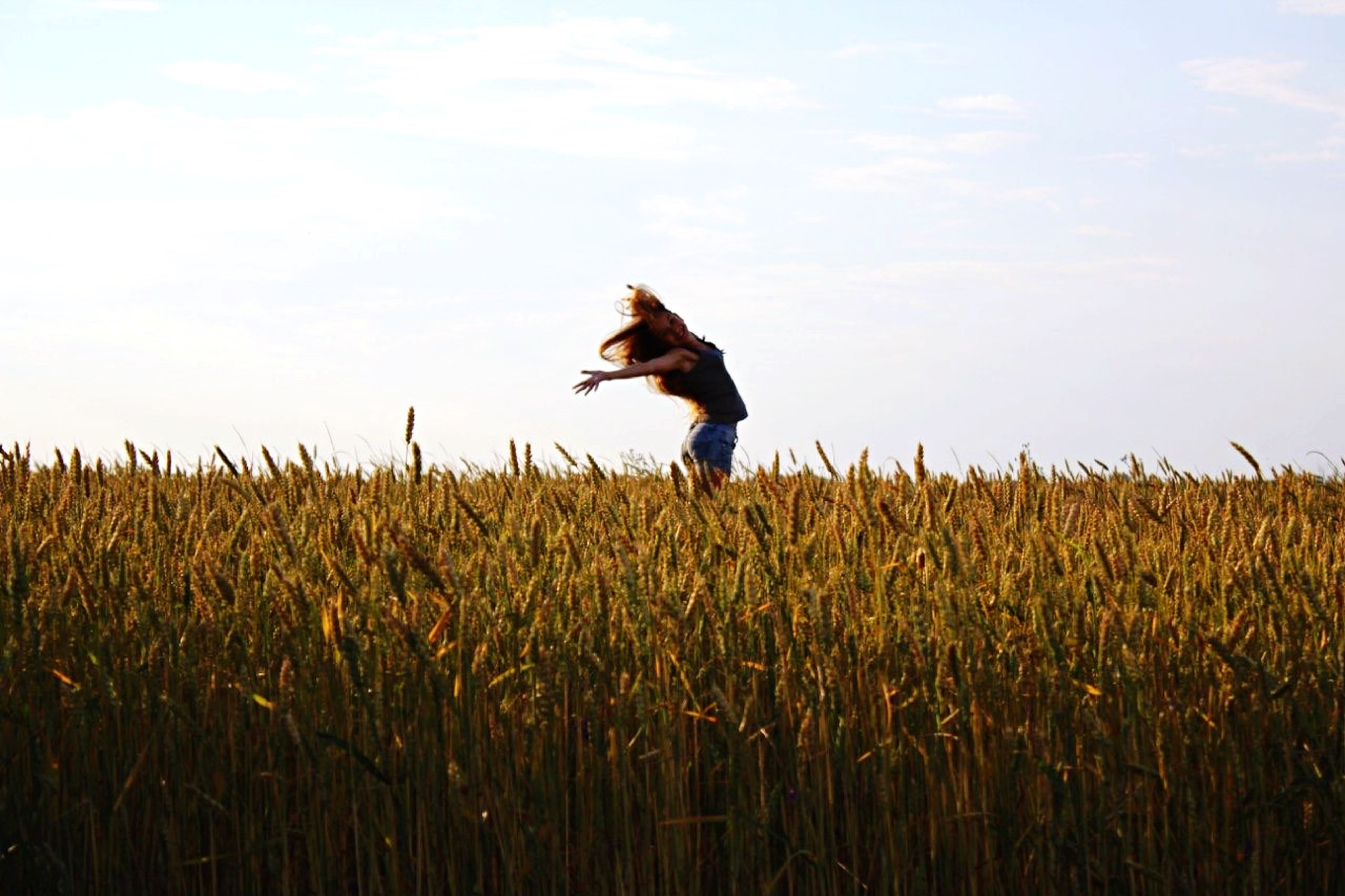 animal themes, one animal, grass, field, full length, sky, bird, domestic animals, nature, rural scene, standing, landscape, plant, one person, agriculture, growth, farm, tranquility, rear view, pets